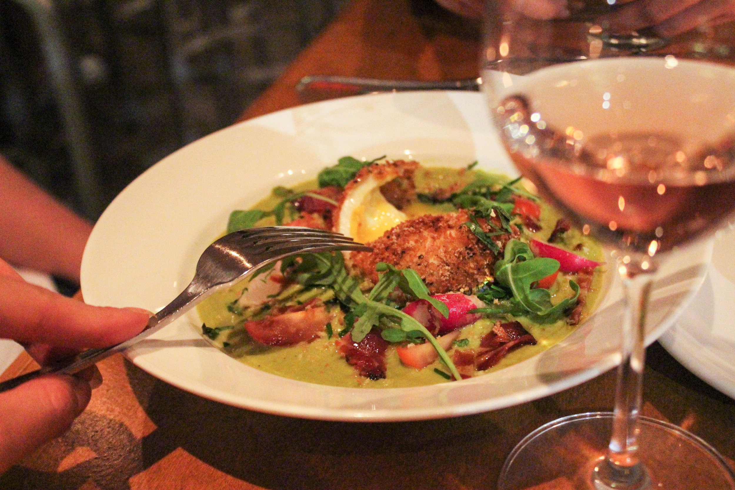 Creamy Asparagus Velouté, Soft Breaded Fried Egg, Herbs, and Bacon at Le Garage