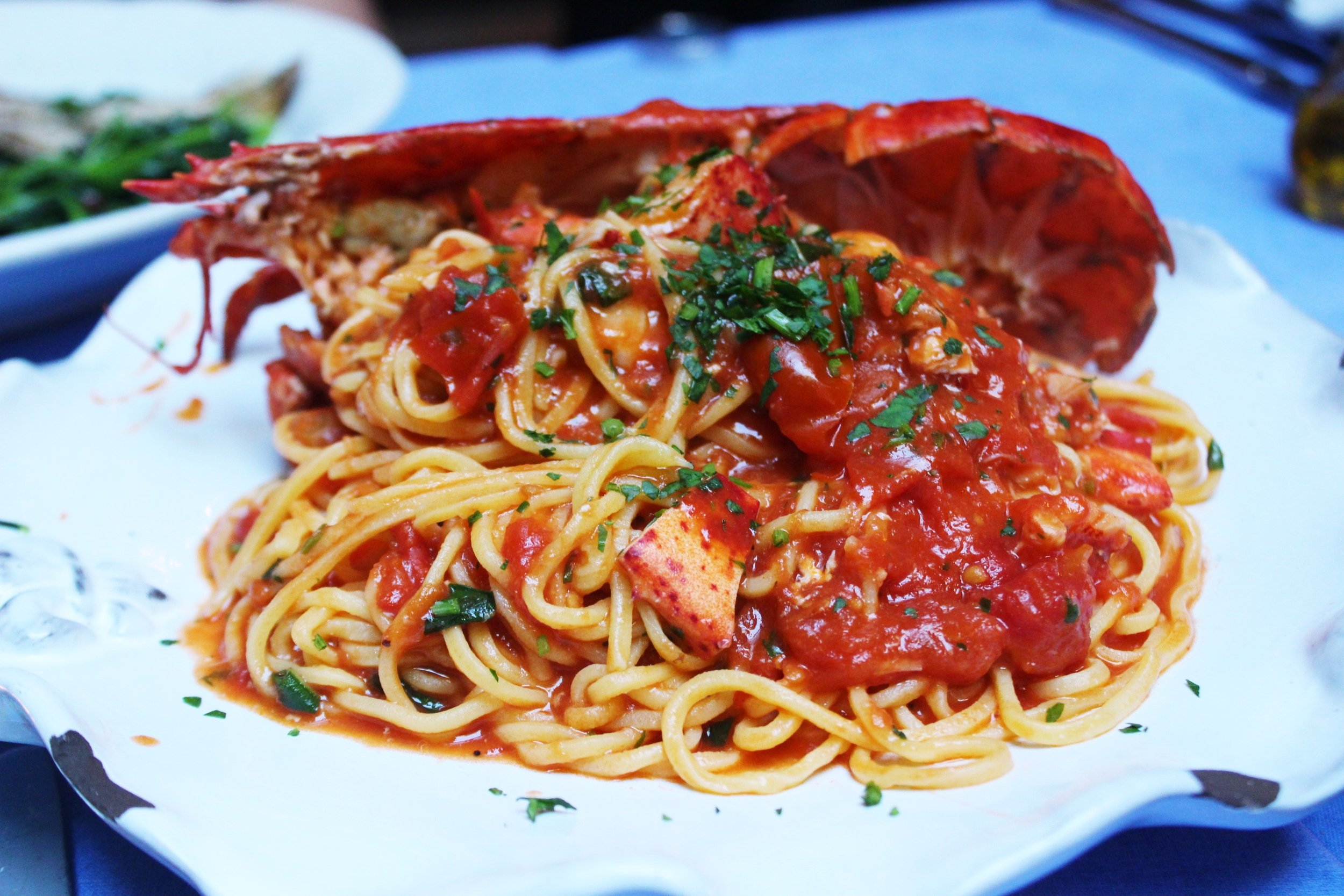 Spaghetti All'astice Half Maine Lobster With Homemade Spaghetti In A Sauce Of Lobster, Cherry Tomato And Brandy