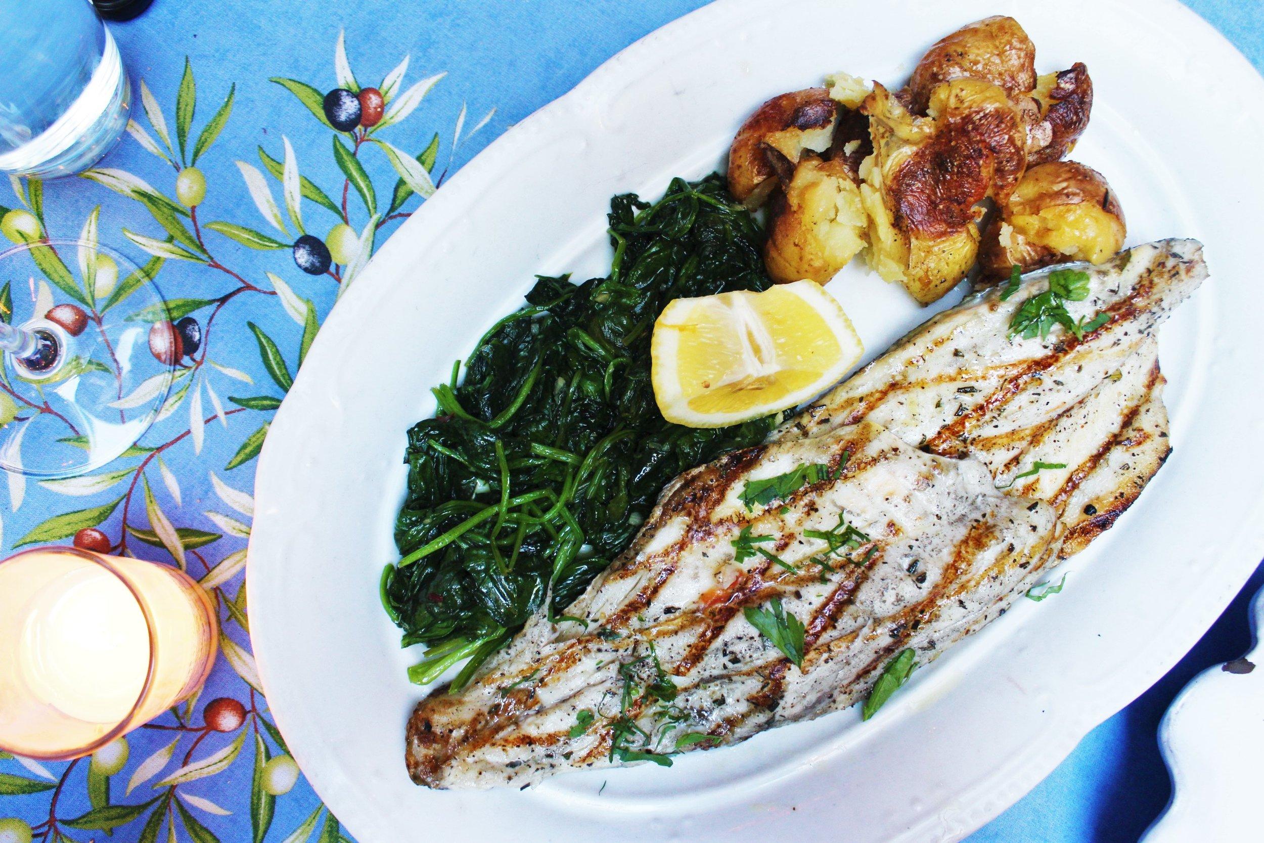 Branzino Alla Griglia Grilled Italian Sea Bass With Sautéed Spinach And Herb-Pressed Potatoes