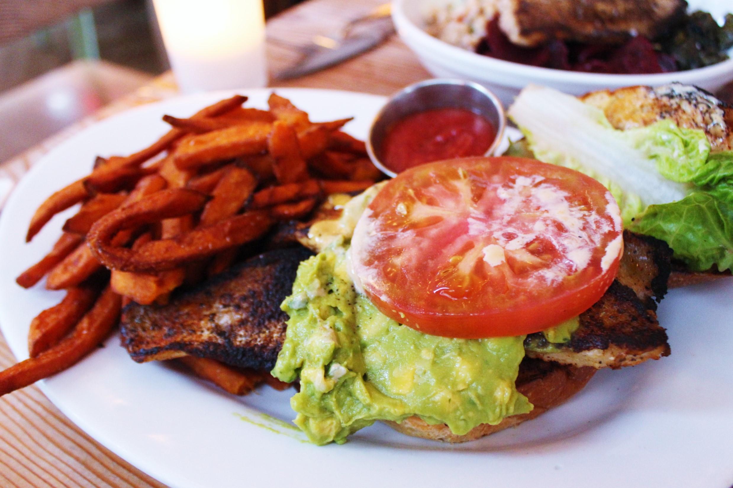 Blackened Catfish Sandwich with Avocado, Citrus Aioli, Lettuce, Tomato and Sweet Potato Fries