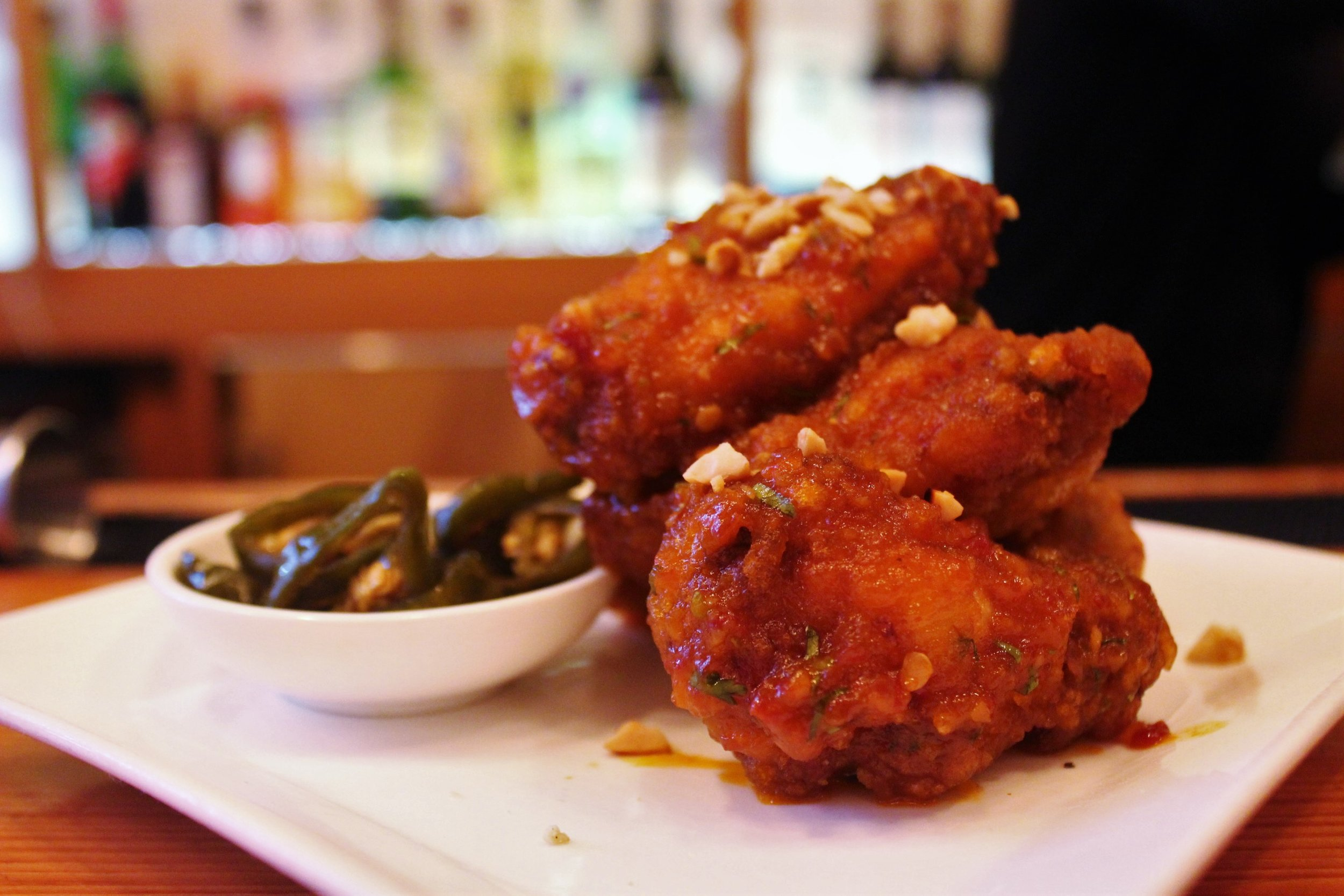 Spicy Korean Fire Chicken Wings with Honey, Garlic, Four Chilies, and Peanuts at Danji
