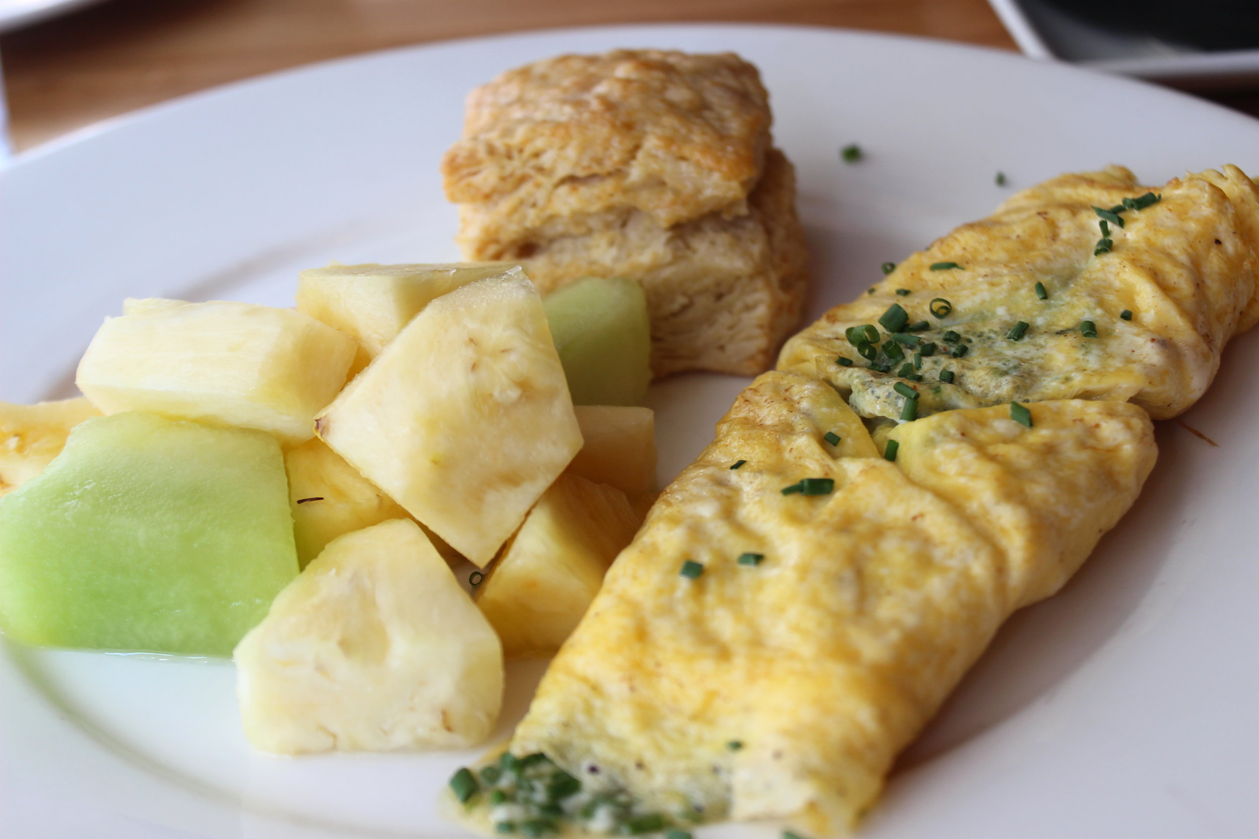 Omelet with Farm Fresh Eggs, Seasonal Fruit, House-made Buttermilk Biscuit