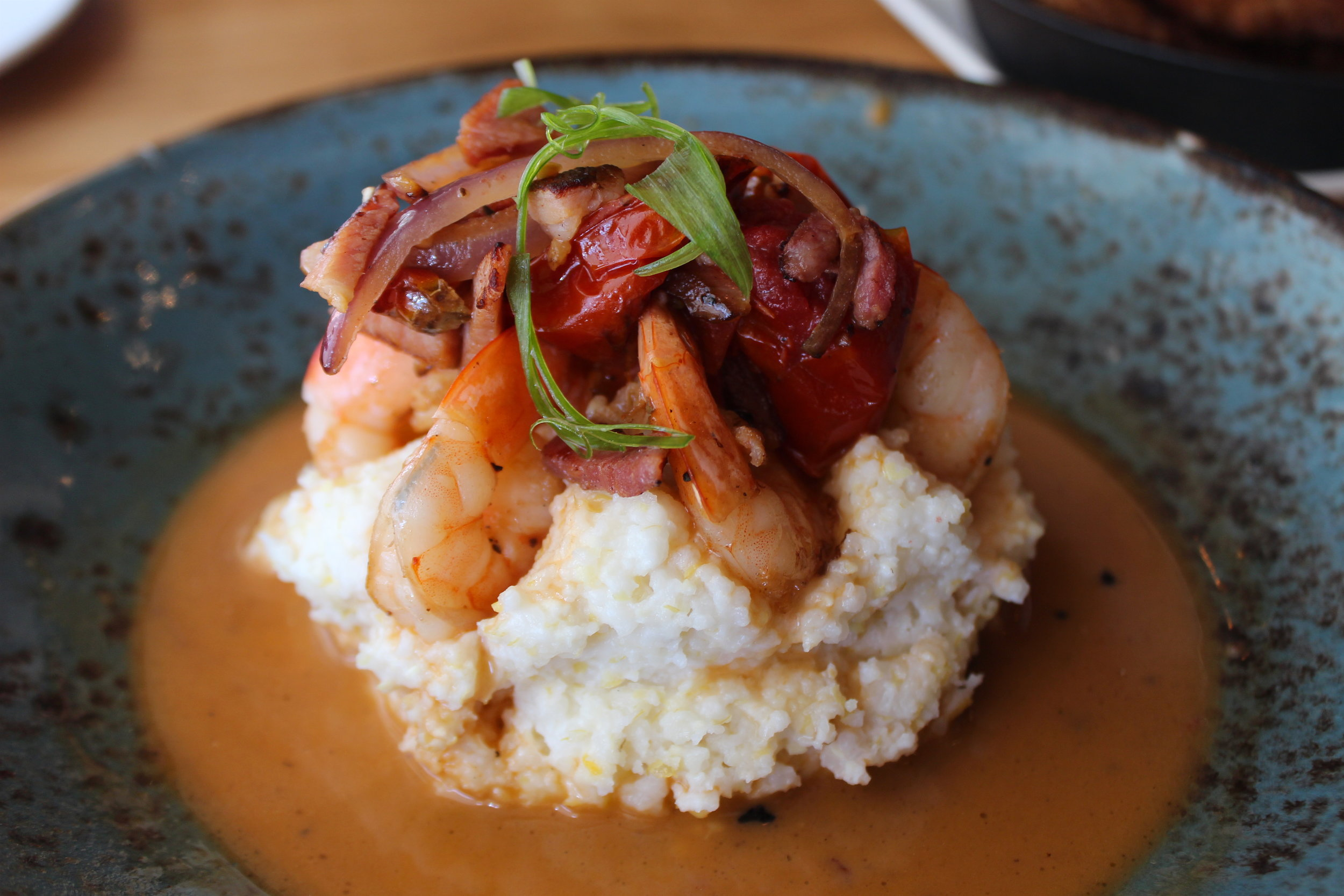 Shrimp n' Grits: Seared Shrimp, Roasted Tomatoes, Virginia Ham, Nora Mill Grits, PBR Chicken Jus