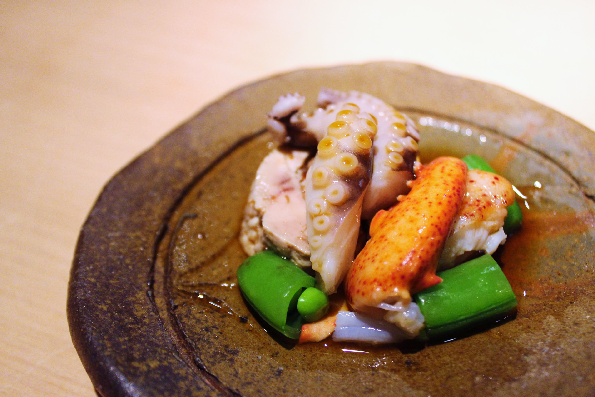 Lightly Poached Maine Lobster, Octopus from Portugal, Steamed Monk Fish Liver, Sugar Snap Peas with Citrus Soy Sauce