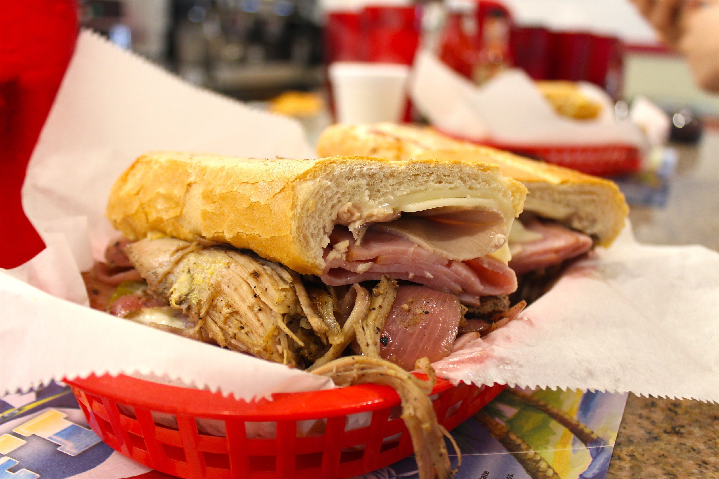 Double Cuban Sandwich (Ham, Cheese, Pork, Mustard, Roast Pulled Pork, Spanish Mojito Sauce with Onions) at Enriqueta's