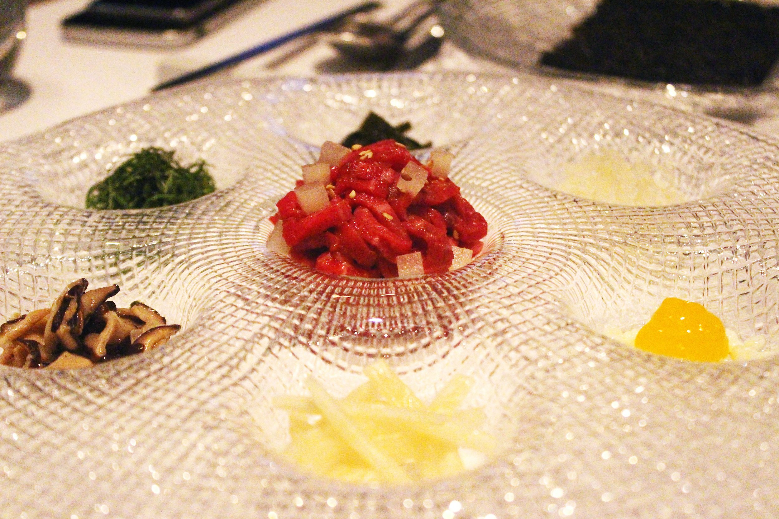 Gu Jeol Pan: Beef Tartare with Crispy Seaweed and toppings