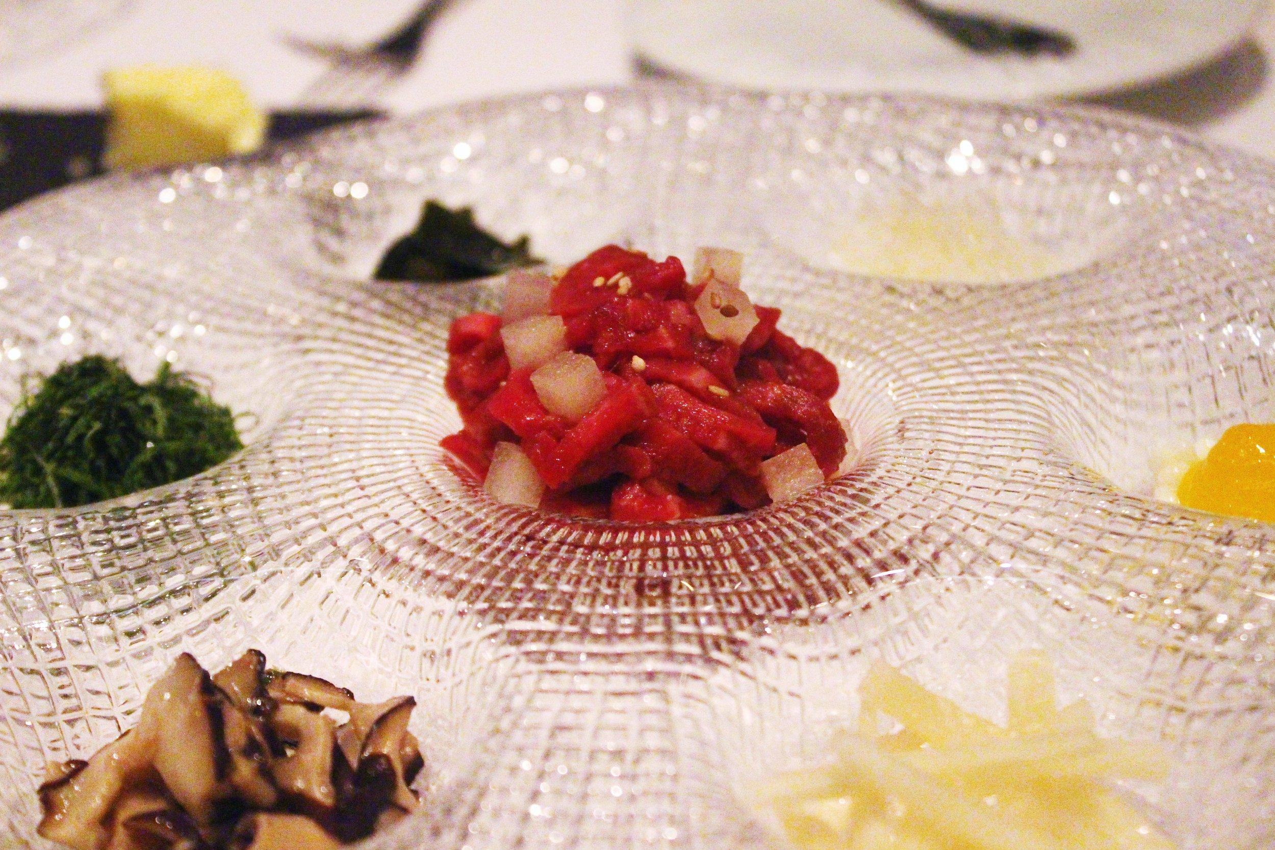 Gu Jeol Pan: Beef Tartare with Crispy Seaweed and toppings