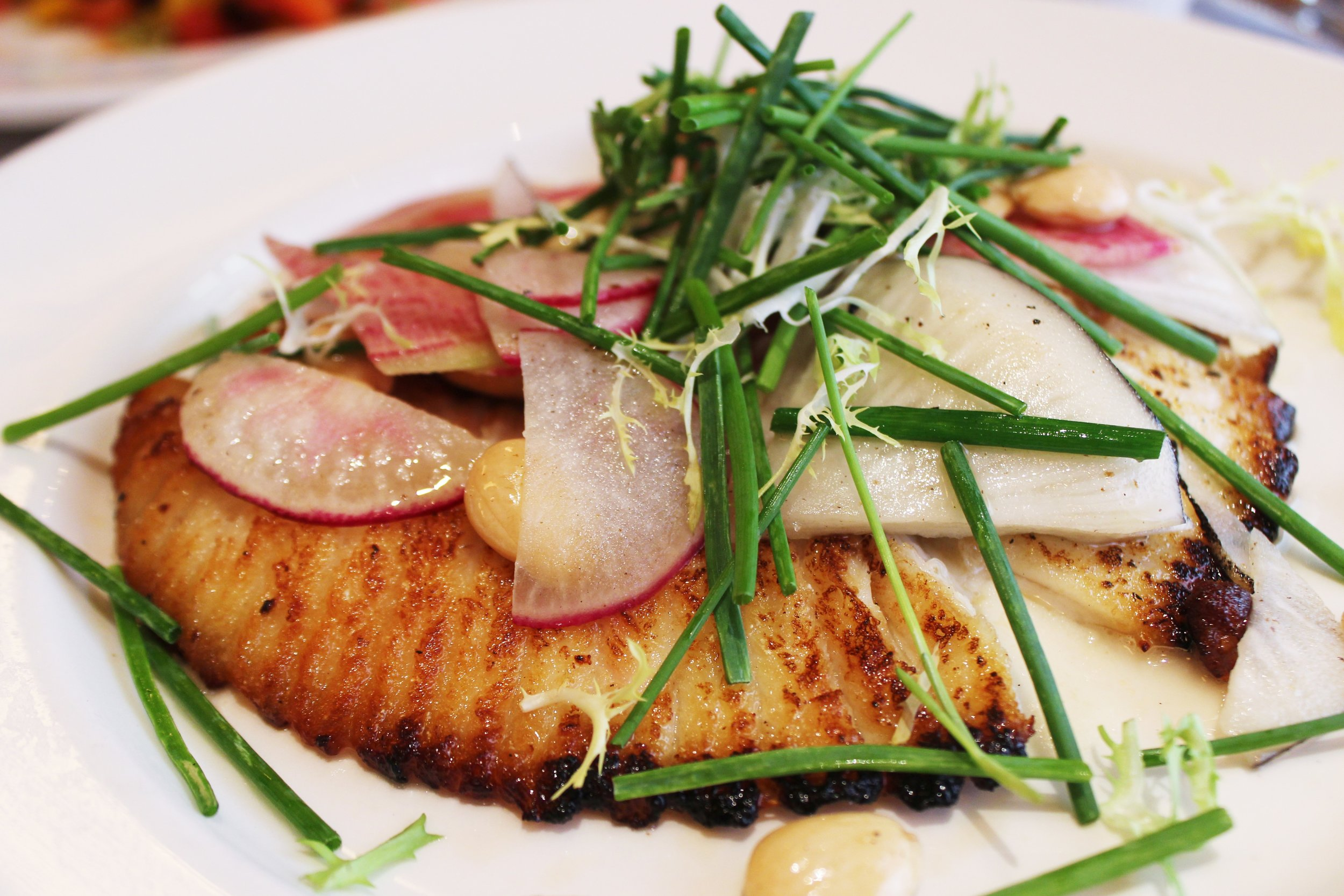 Sautéed Skate with summer beans, radish, marcona almonds and spring onion soubise at Balthazar