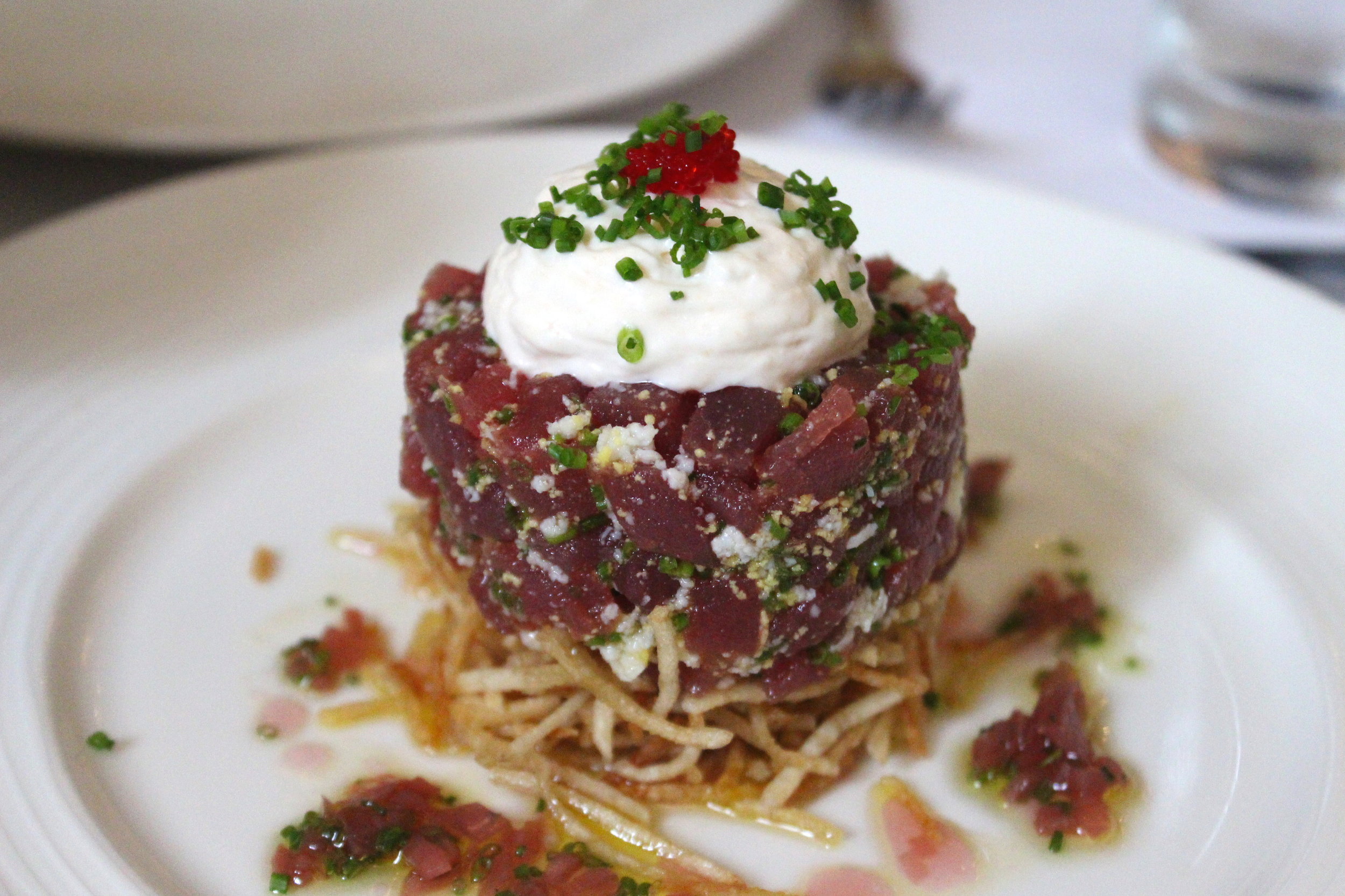 Tuna Tartare, potato kataifi, tarama espuma, and pickled shallot vinaigrette