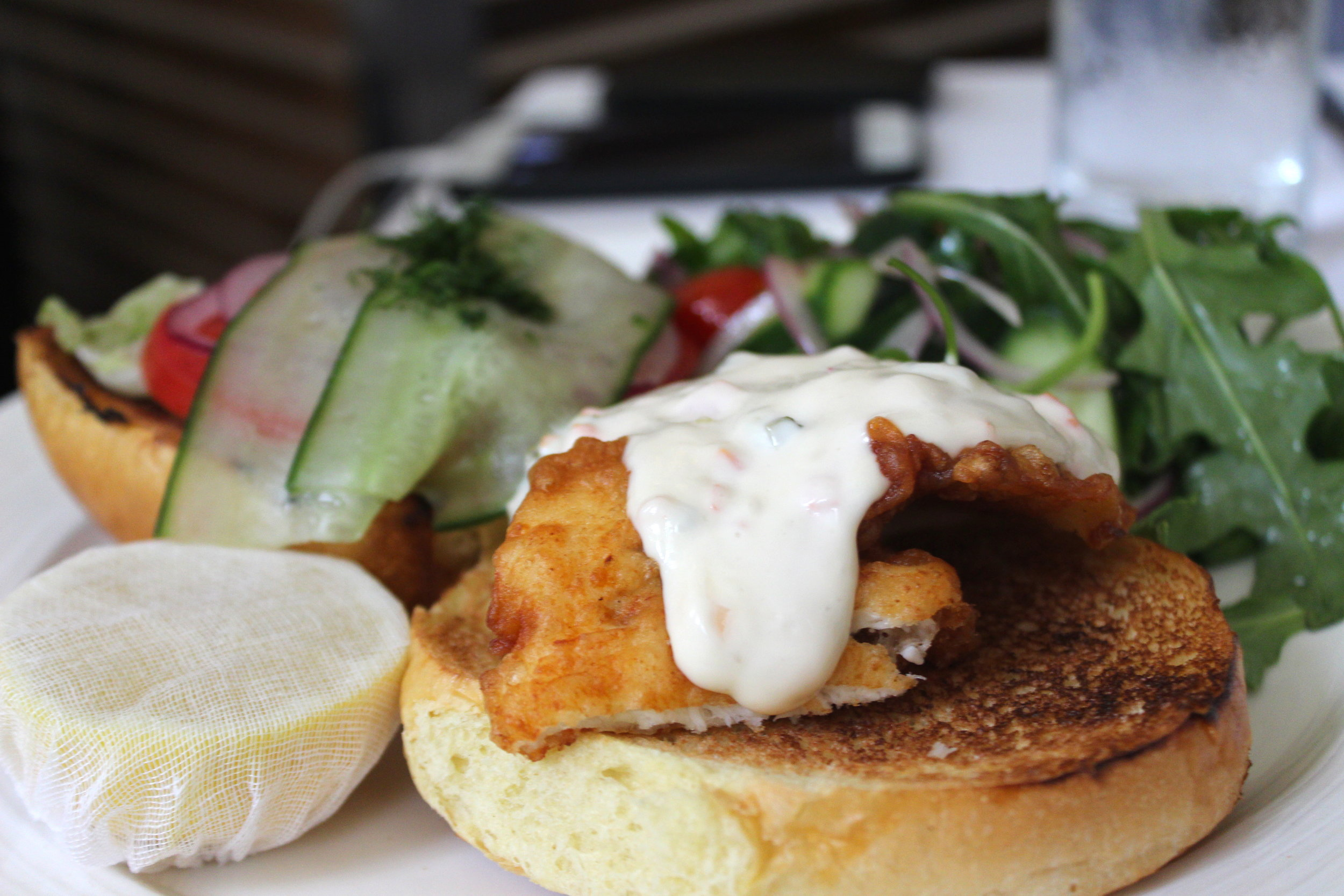Fish Sandwich, beer battered, sliced red onions, and tzatziki tartar sauce