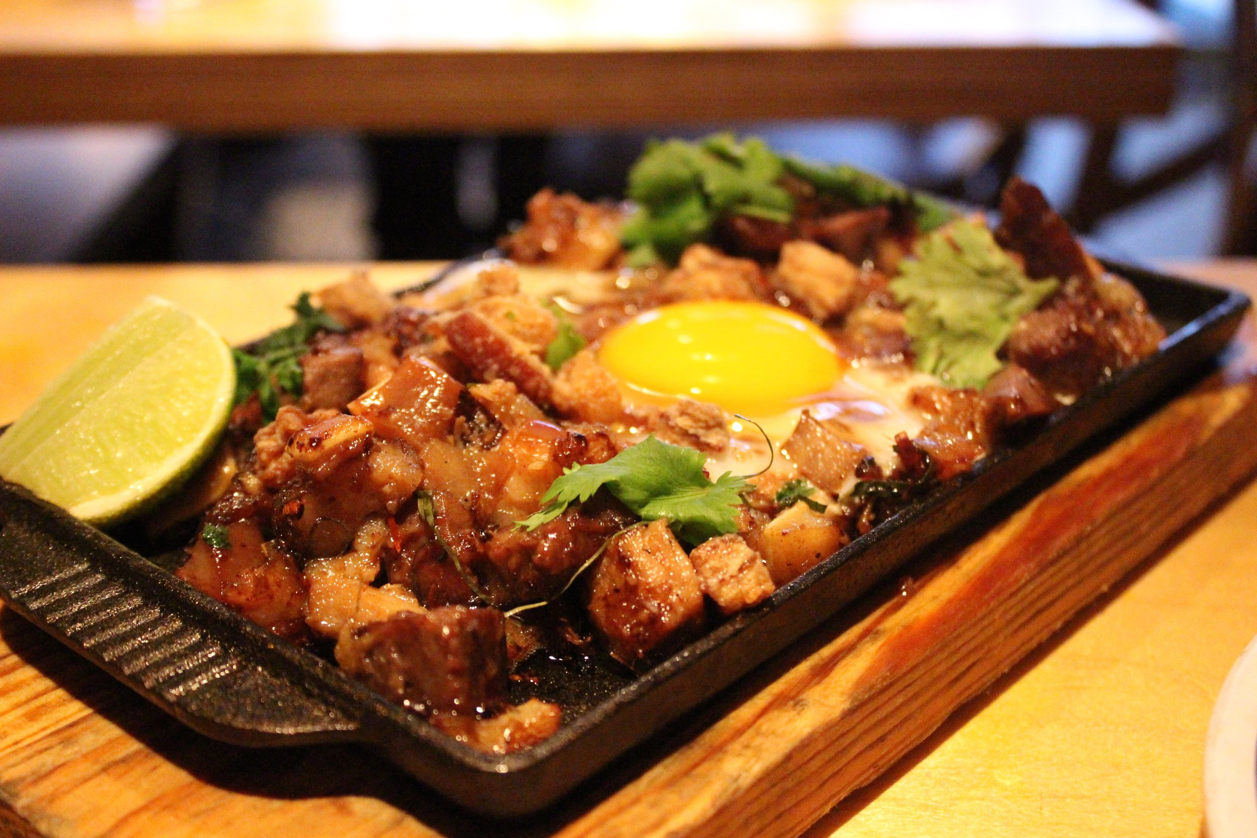 Sizzling Sisig: Pork Head, Chili, Whole Egg