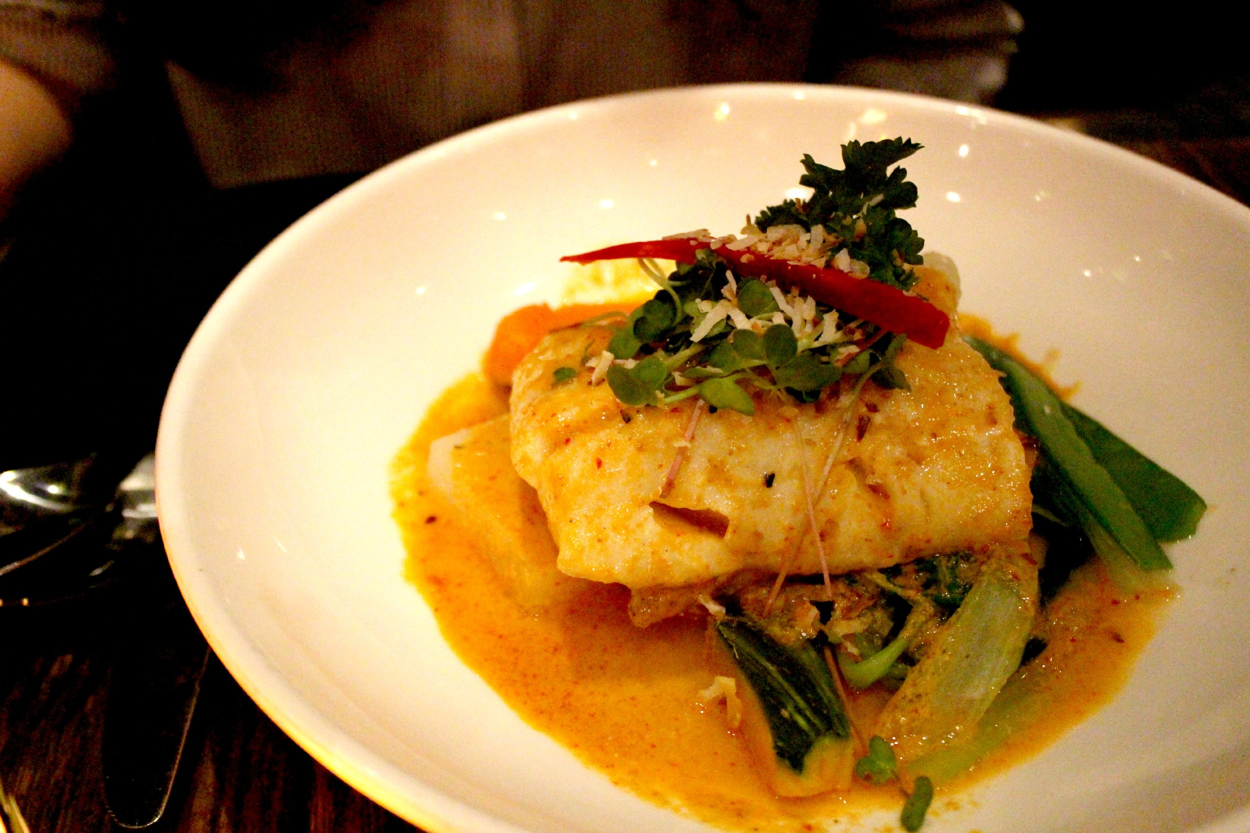 Cod Shu Shee: Pan Roasted Fillet of Alaskan Cod with Thai Curry, Bell Peppers, Kale, Kaffir Lime Leaves Topped with Coconut Milk at Up Thai