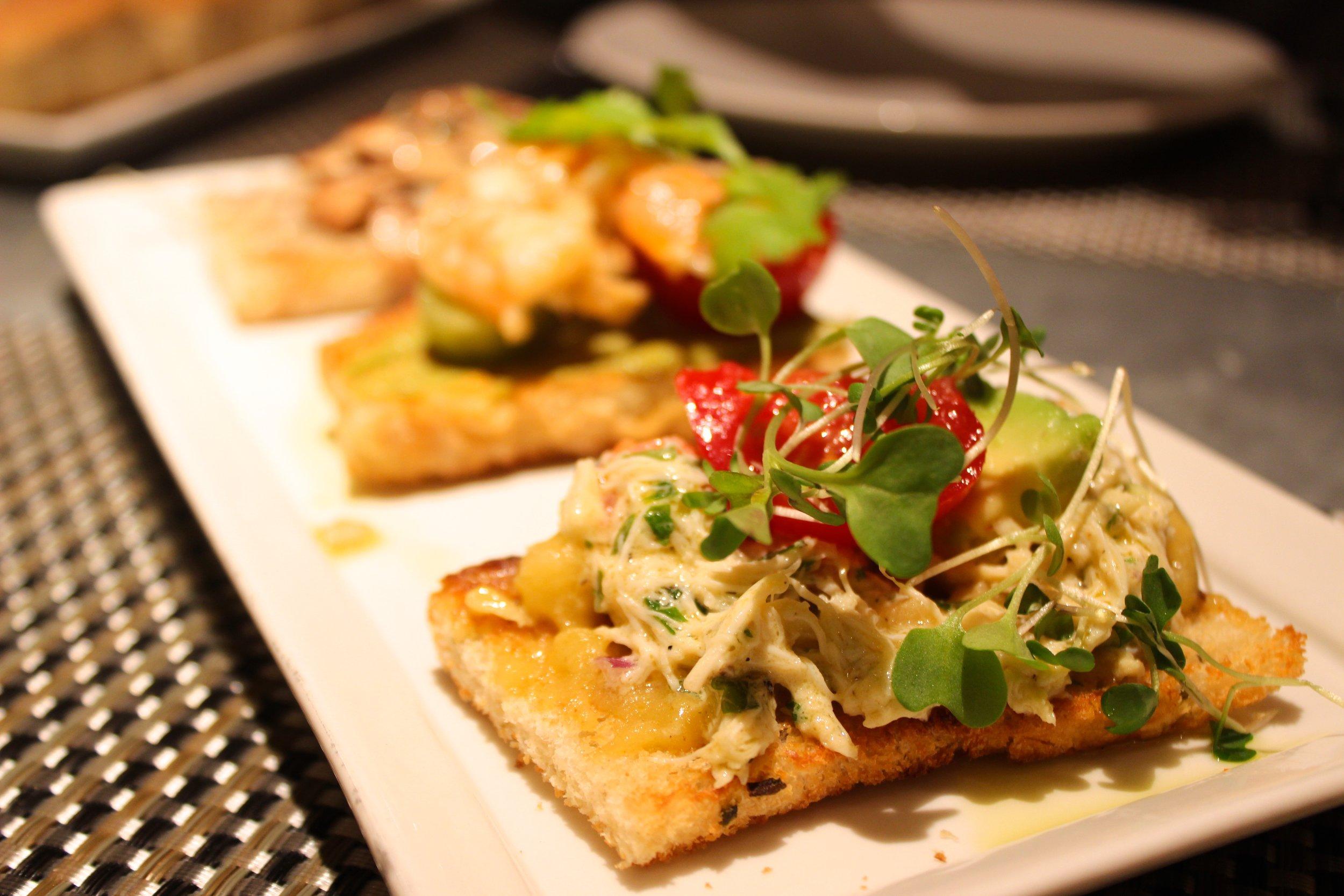 Crab, Heirloom Tomato, Avocado, Apple Aioli Crostini at Fig & Olive