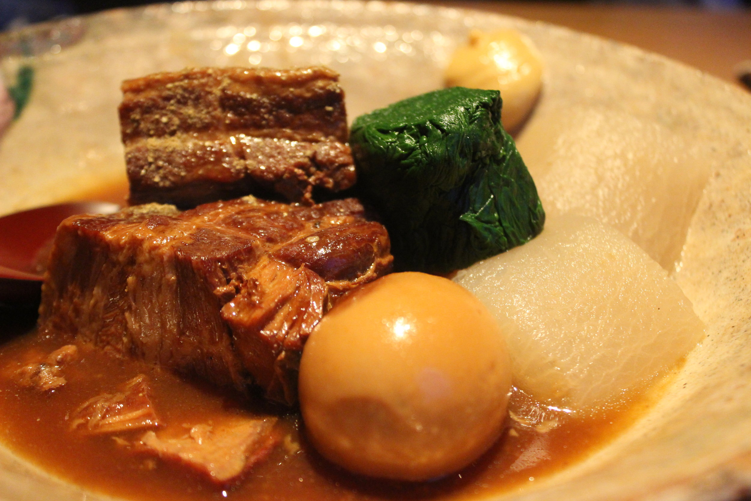 Kurobuta Kakuni: Braised Berkshire pork belly in sansho miso served with a hard boiled egg, spinach and daikon radish