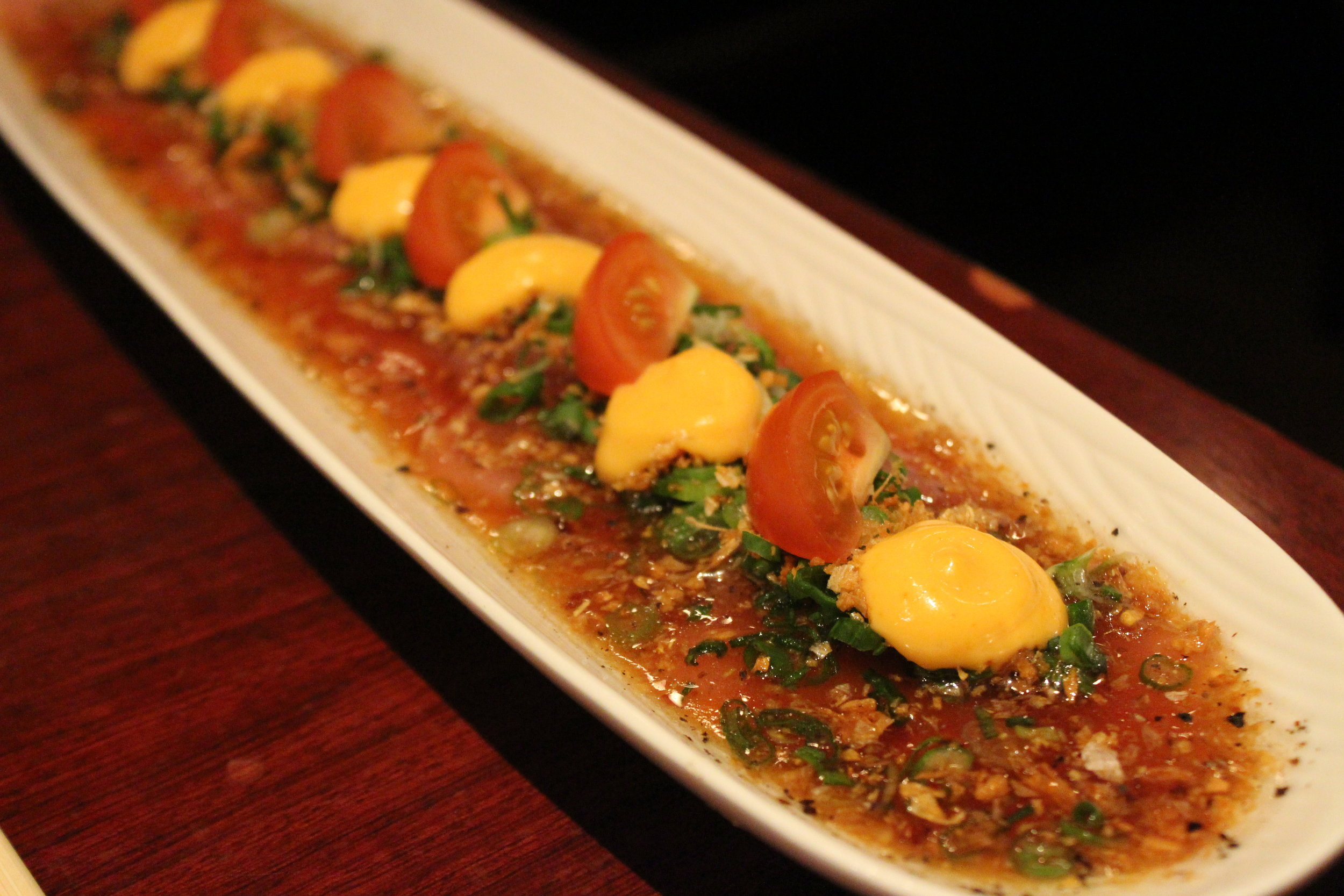 Spicy Tuna Carpaccio with Scallions, Fried Garlic Chips, and Spicy Mayonnaise at Hakata Tonton