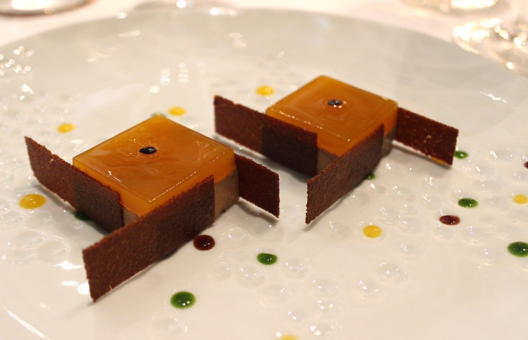 Spicy Foie Gras with Passion Fruit Jelly brewed with Coffee at Le Cinq