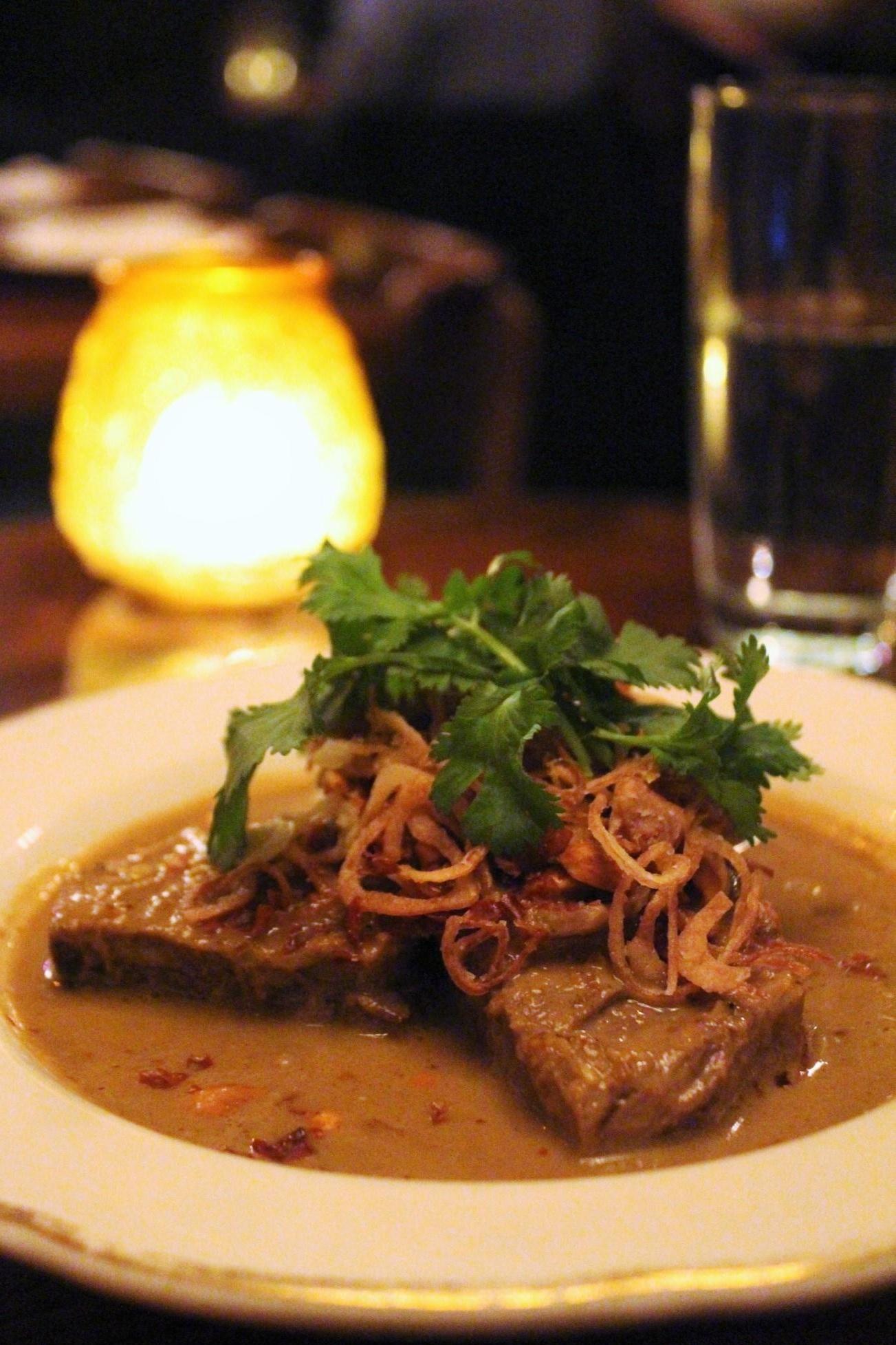 Massaman Neuh: Boneless Beef Ribs with Massaman Curry, Potato, Red Onion, Peanut, and Green Peppercorn at Uncle Boons