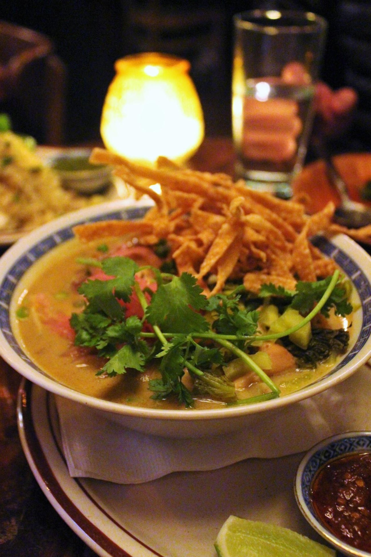 Khao Soi Kaa Gai: Northern Style Golden Curry with Homemade Egg Noodles, Chicken Leg, Pickled Mustard Greens, and Fresh Tumeric at Uncle Boons