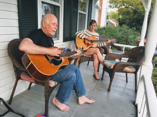 Jon pickin' on the porch with his daughter Kristin