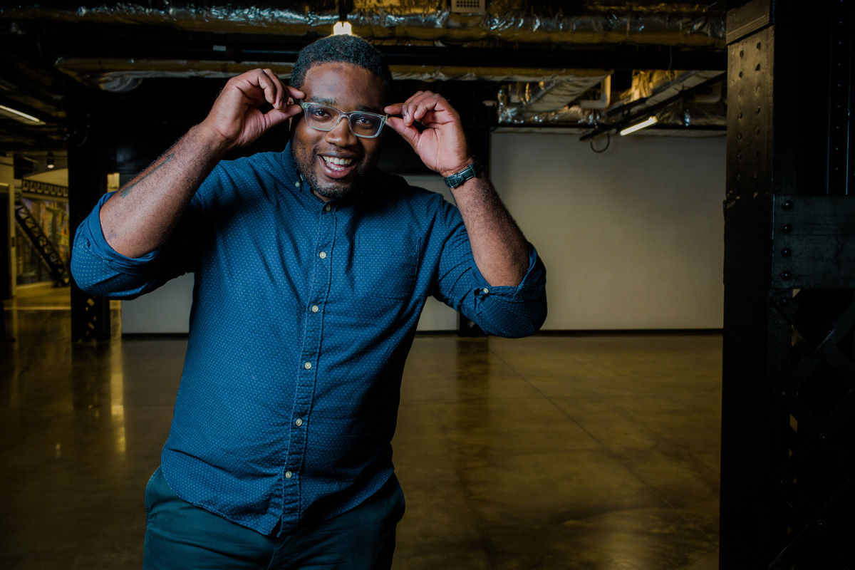 hip black man with glasses