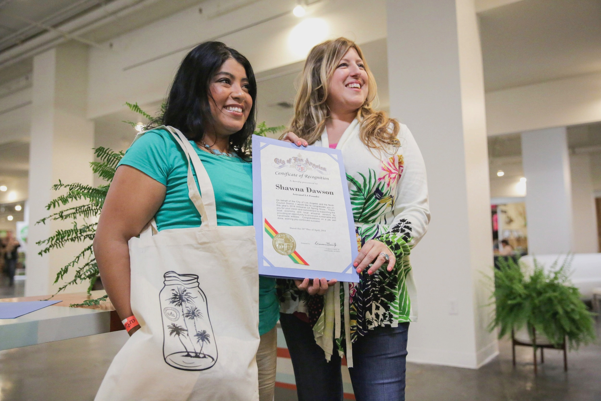Founder Shawna Dawson (right) holding City Recognition Award.