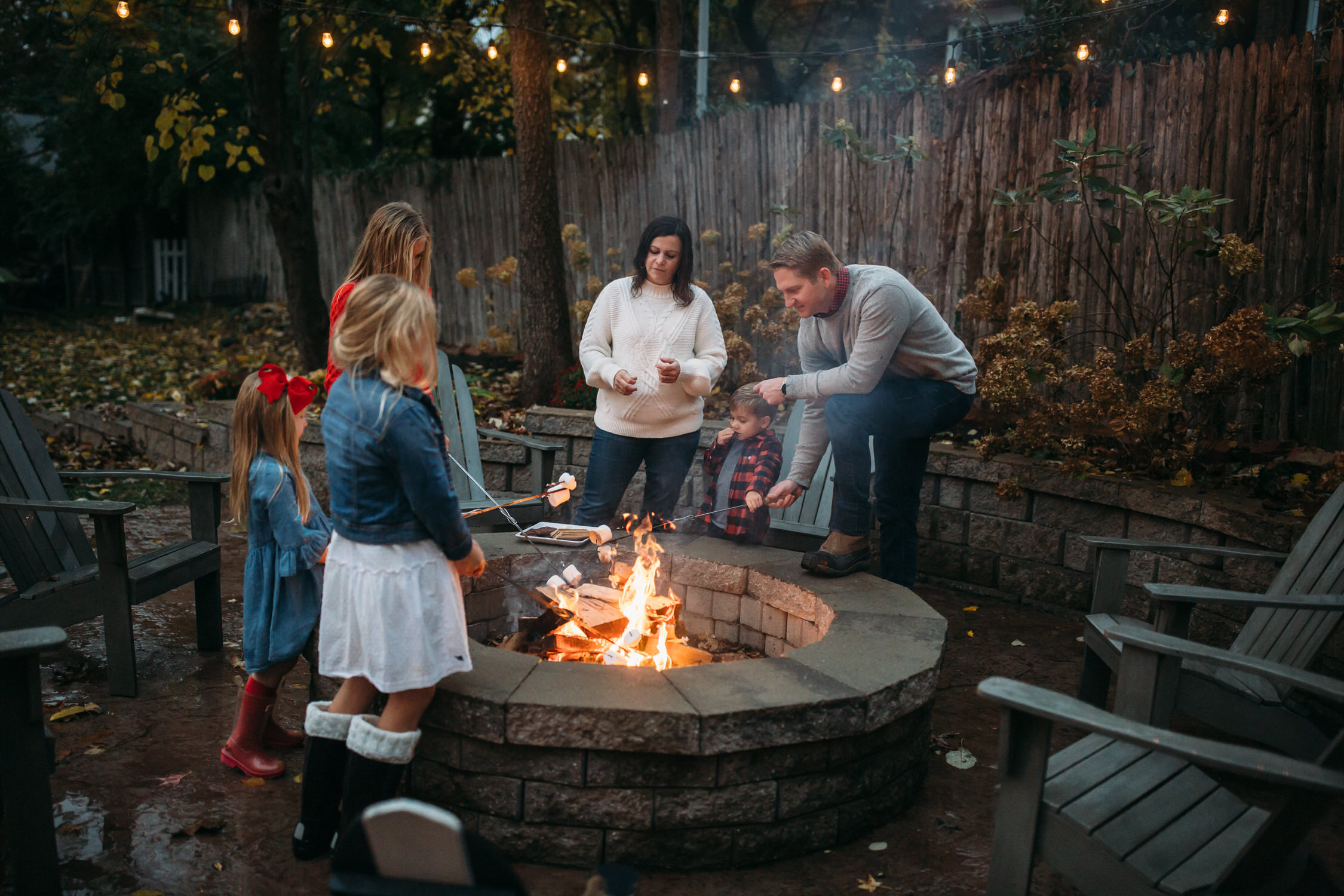Camping and making s'mores as a family, family adventure, back yard family photos