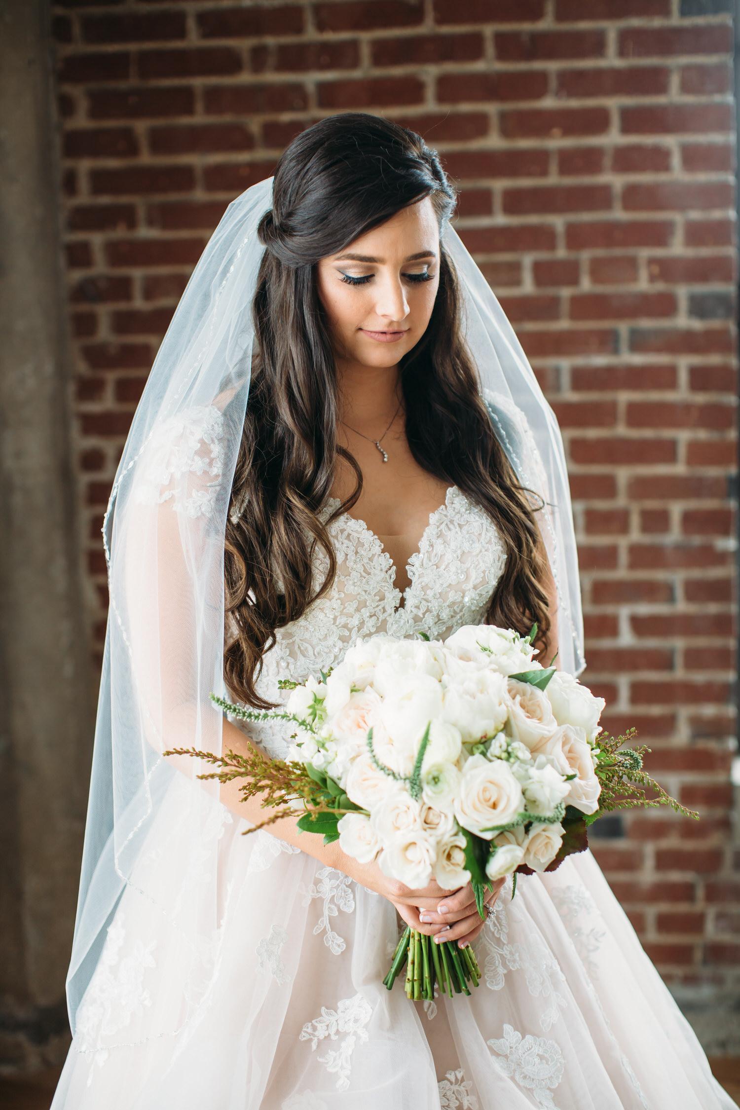 Bridal portrait of the bride with her wedding bouquet. St Louis wedding photographer