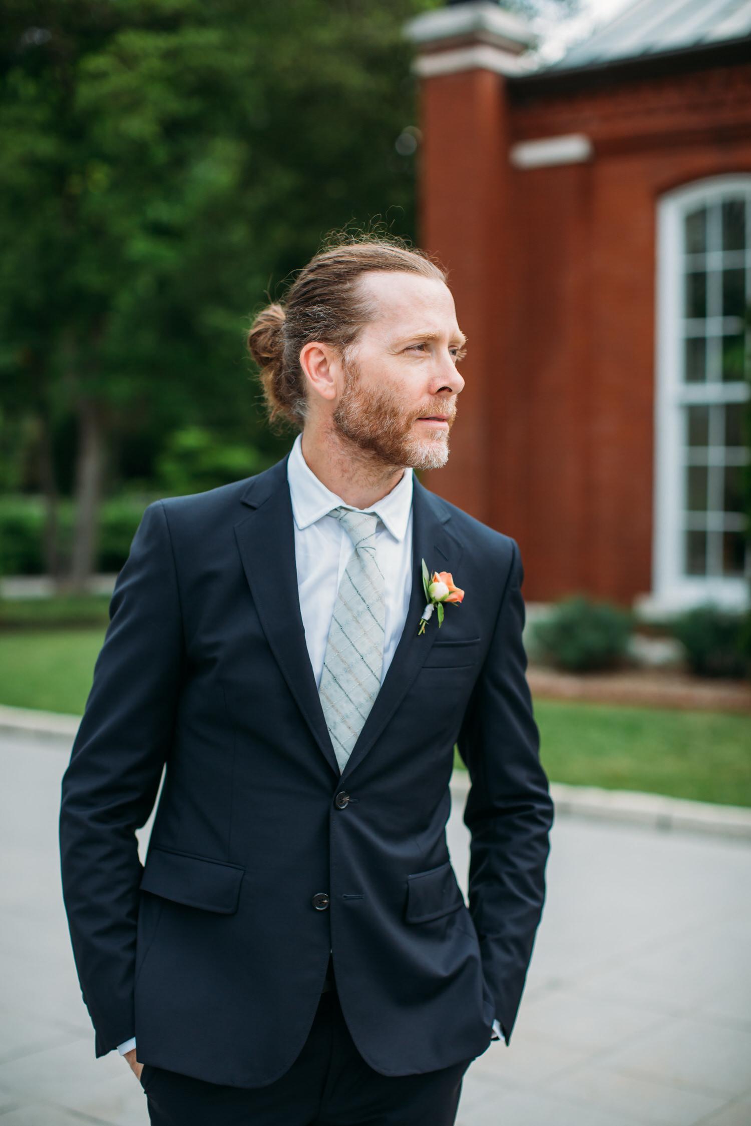 stylish groomsman St Louis Wedding Photographer