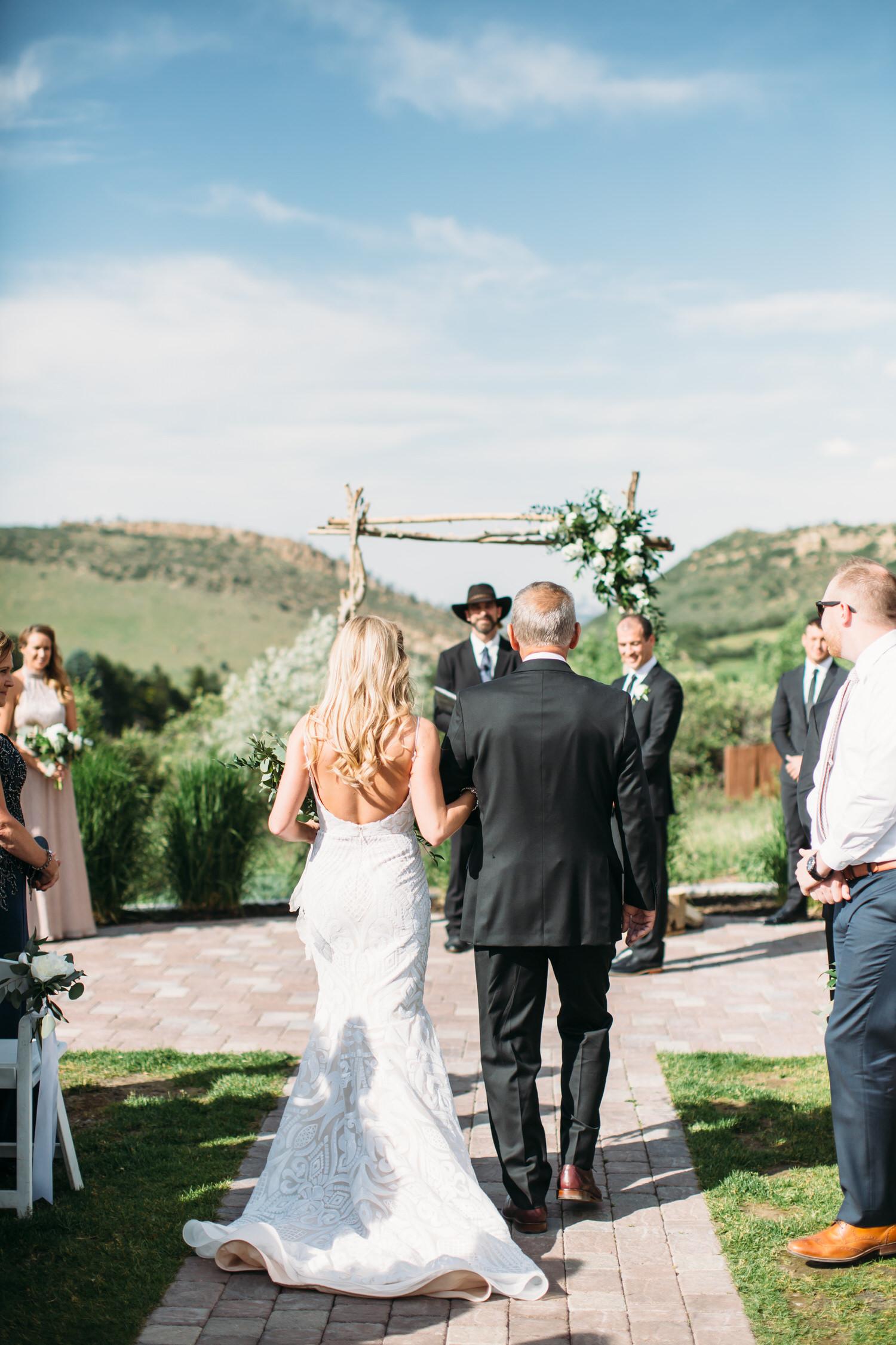 Mountain wedding, Denver Colorado wedding photographer, bride walking down aisle