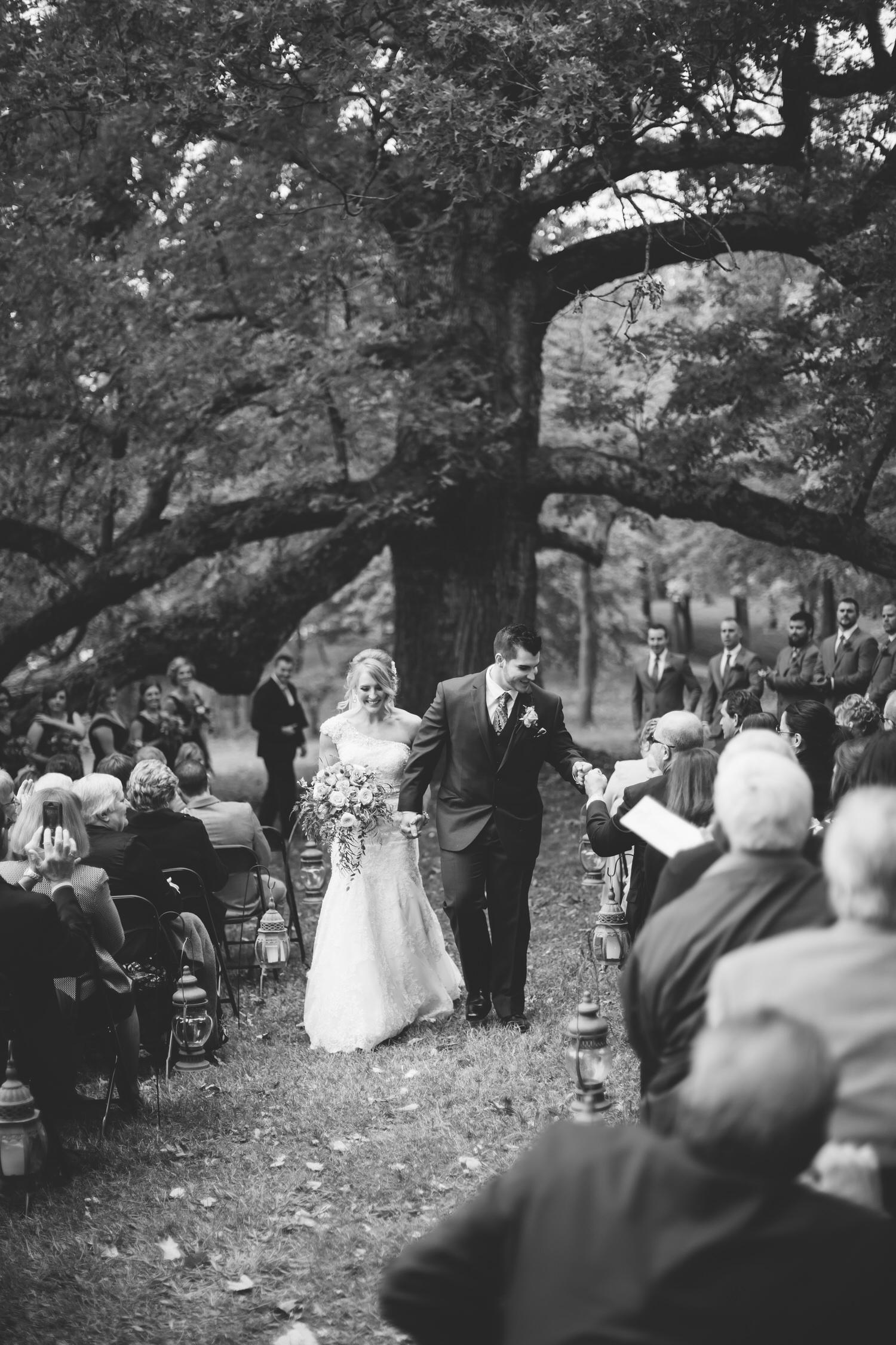 Outdoor wedding, bride and groom walking down aisle, Illinois Wedding Photographer