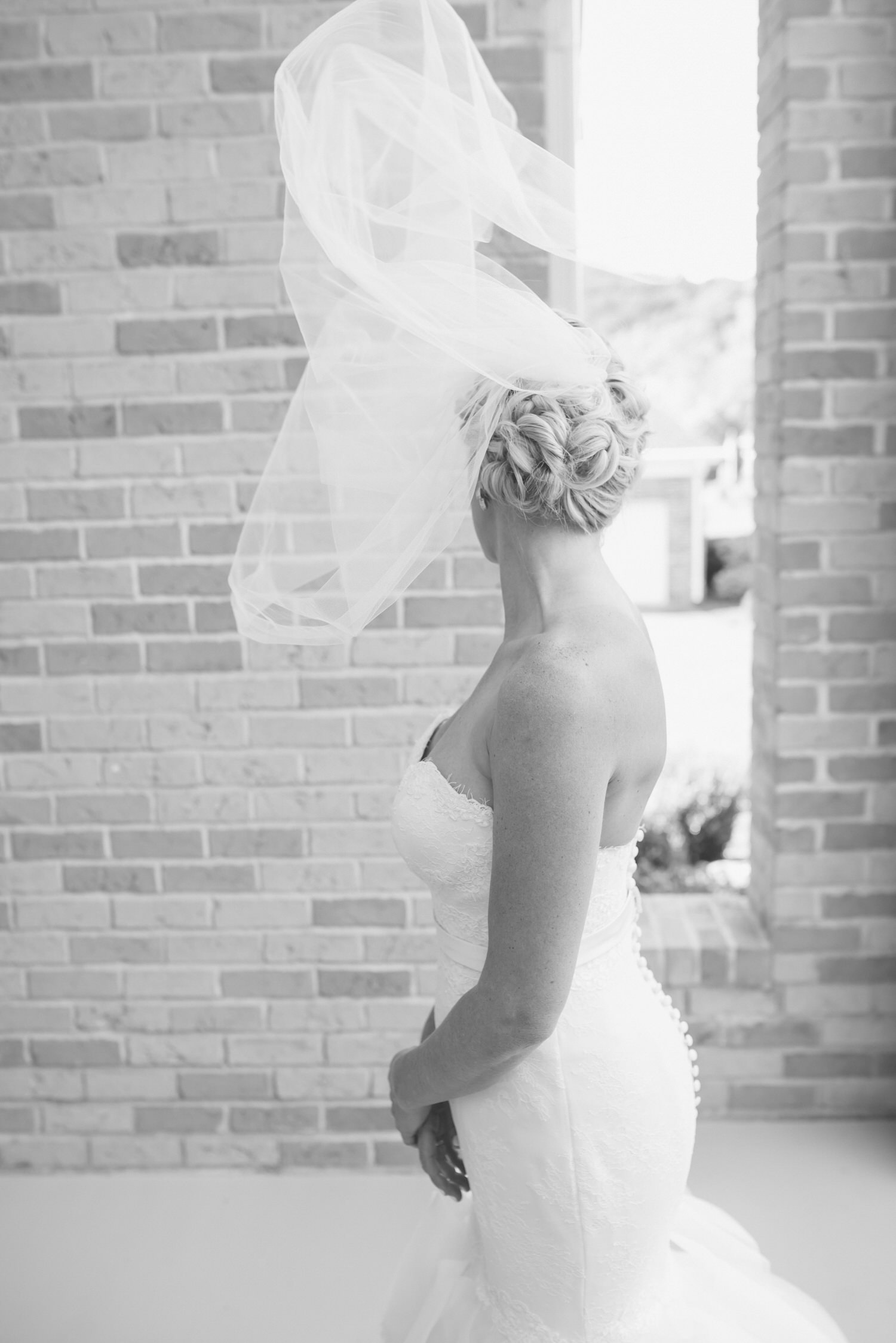 Bride and veil in wind, timeless wedding,