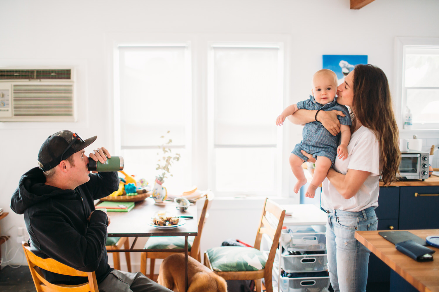 Family of three at home in Los Angeles in a bright white kitchen