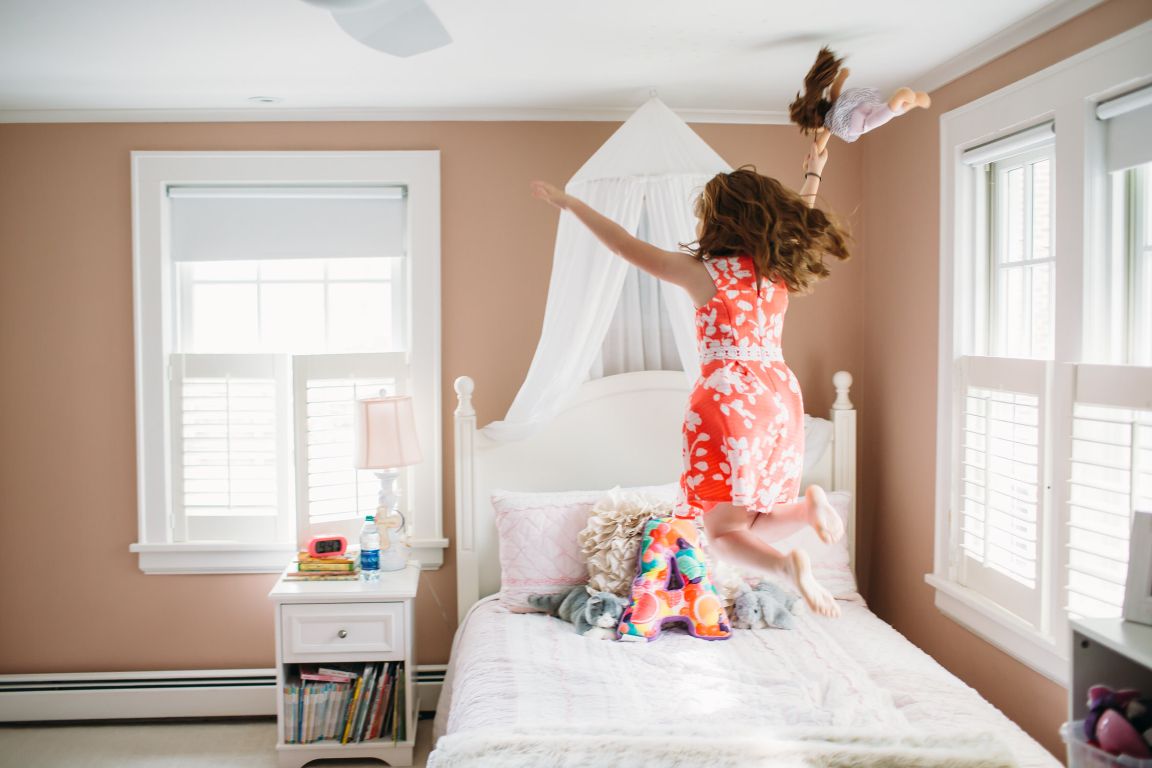 Kids jumping on the bed, Lifestyle family photos at home, Darien Connecticut