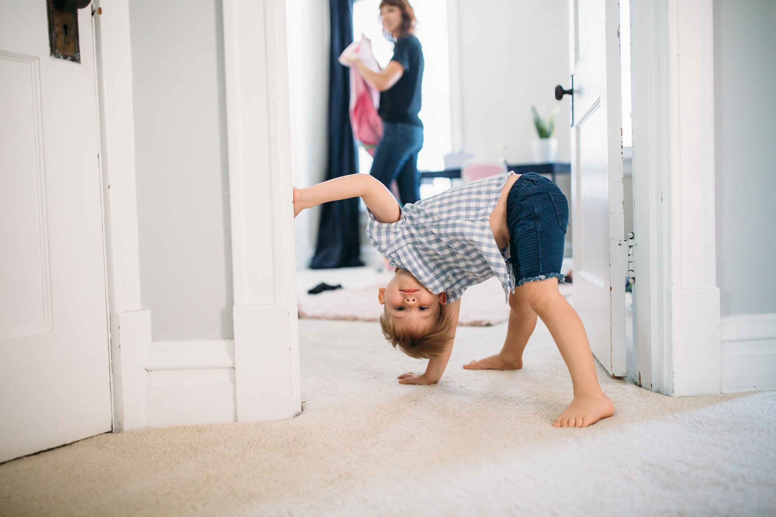 family photography Chicago, natural lifestyle photographer, boy being silly, boy doing cartwheel