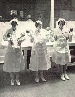 Nurses holding babies