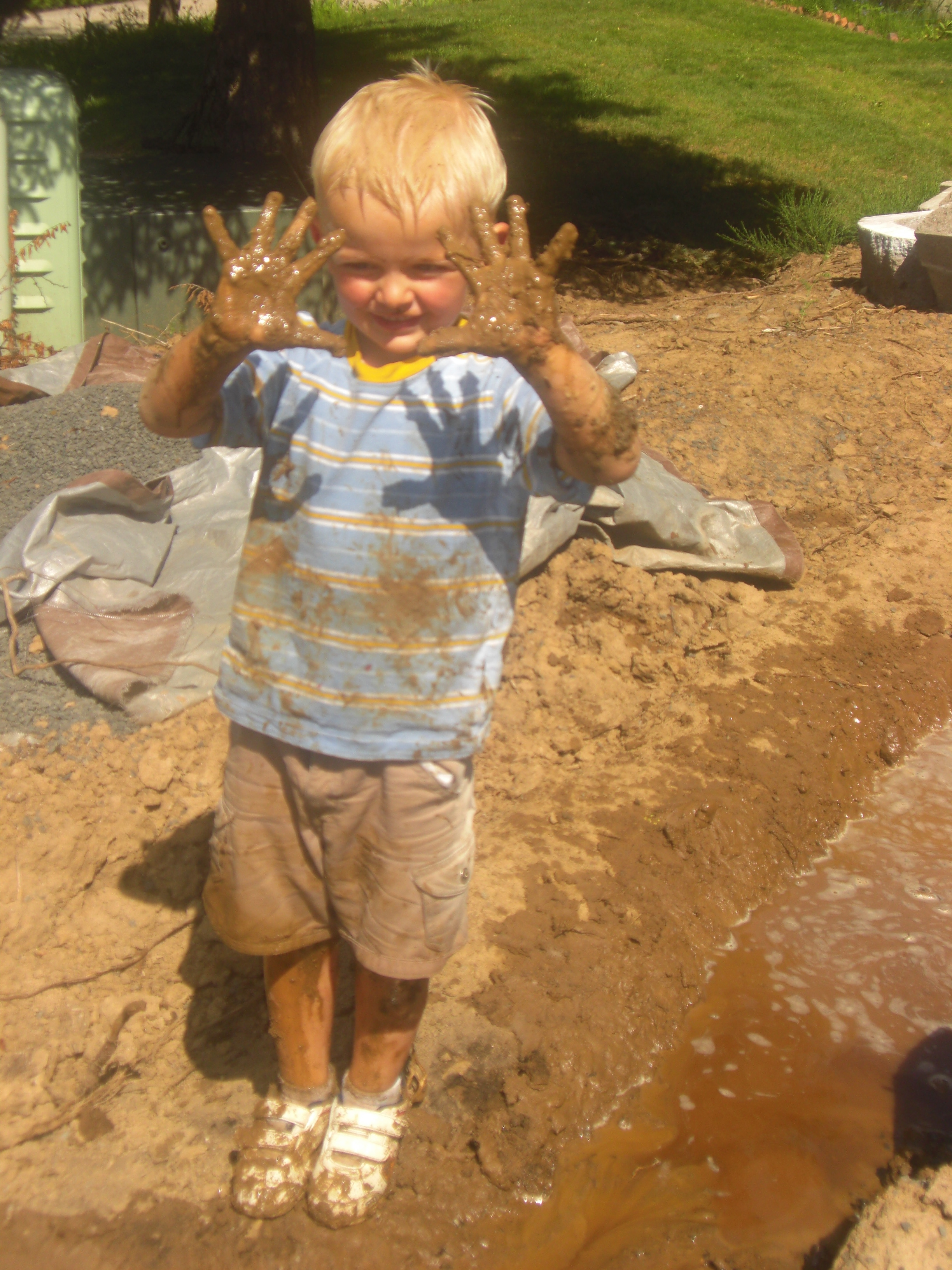 I was slightly less dirty than this! [My oldest back in the day—ultimate mud pies!]