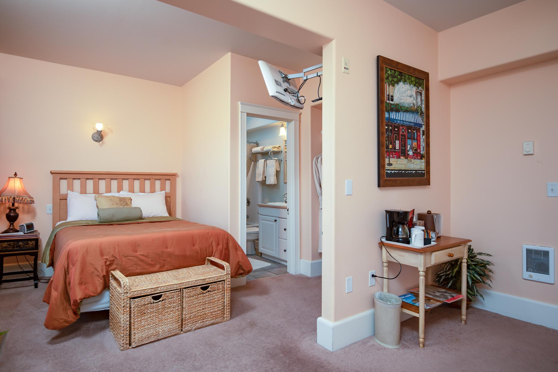 Premium Room - At least 220 square feet. Bedroom with queen bed and sitting area. Bathroom with shower/tub. Sleeps 2 guests and up to 1 child. Complimentary wifi and continental breakfast.