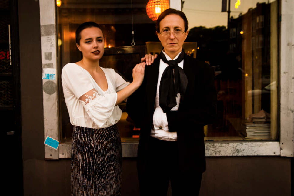 Time-traveling Mary Shelley (Lindsey Tindall) and her father William Godwin (Rebecca Fletcher) pose for a family portrait in front of a storefront in Wicker Park, Chicago. Photo by Matthew Gregory Hollis