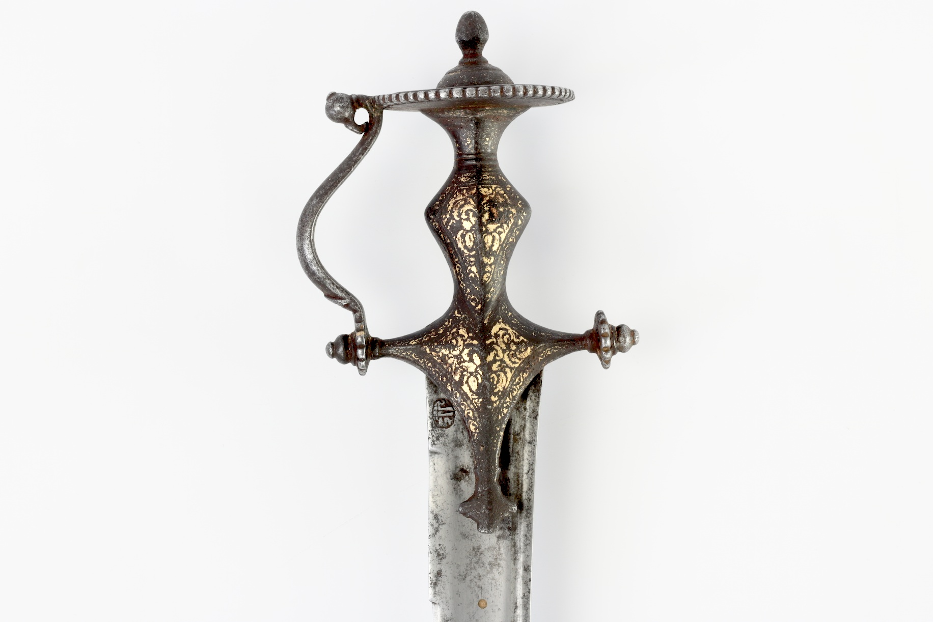 An Indian sword with an inset brass disc. (Source:  Mandarin Mansion )