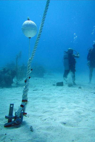 A newly installed mooring line on a Helix sand anchor