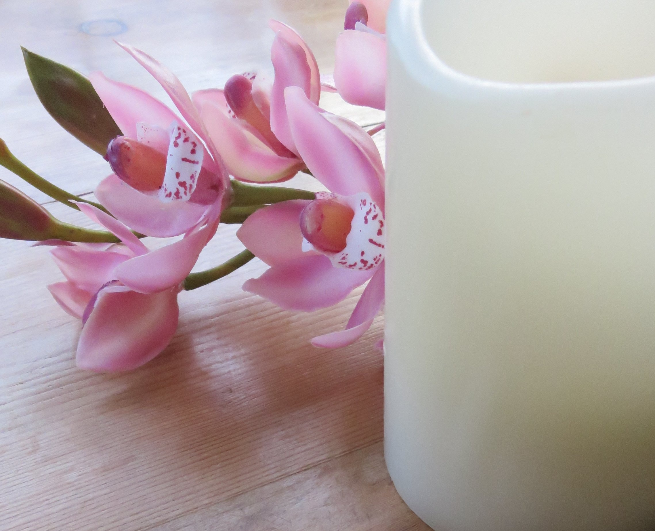 An Artistic Image Of A Beautiful Orchid and Candle For  Emotional Wave Therapy