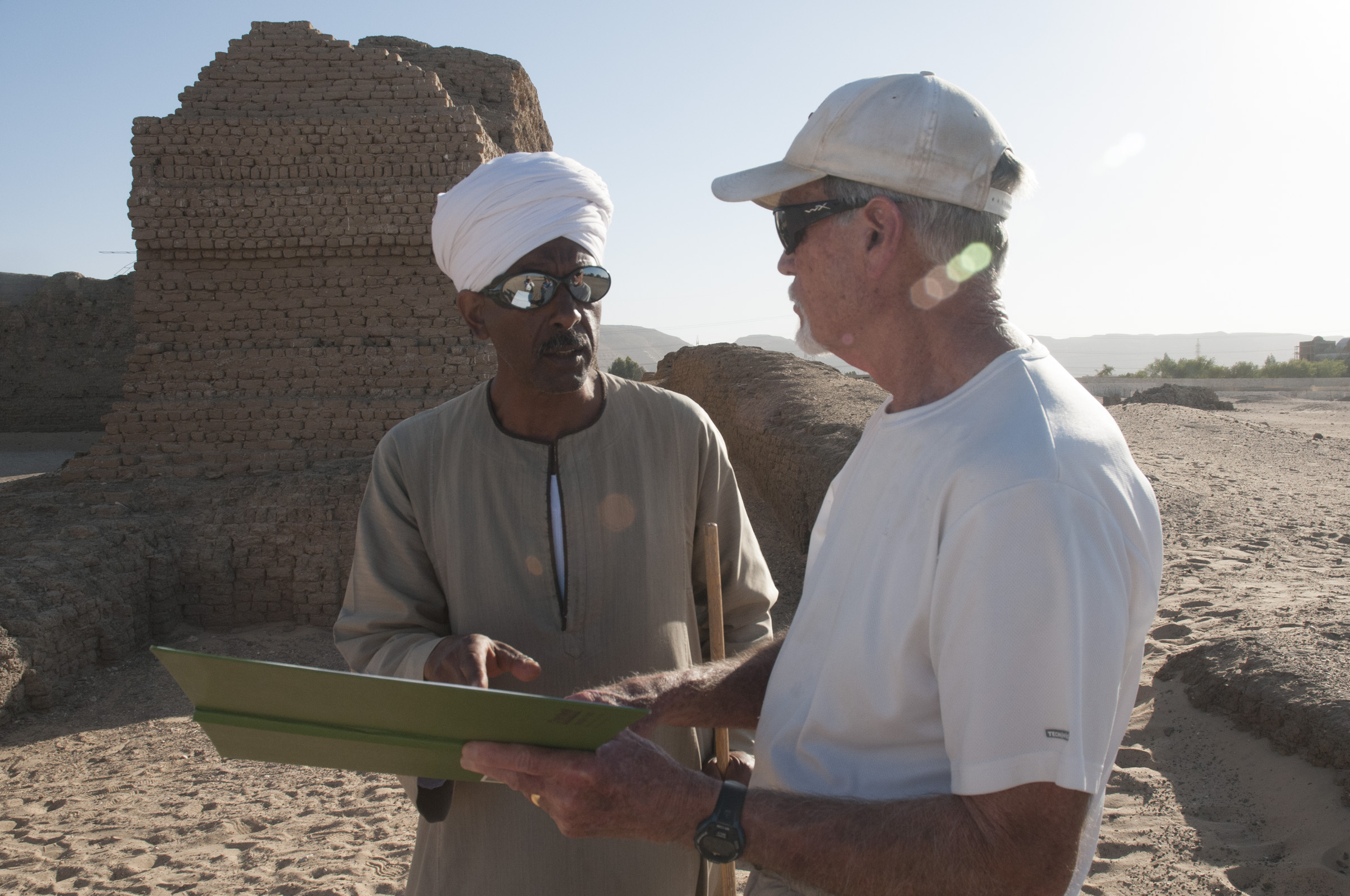 Fig. 4. Reis Ibrahim Mohamed 'Ali and Anthony Crosby at the Shunet el-Zebib. Photo: Matthew Adams / North Abydos Expedition © 2018