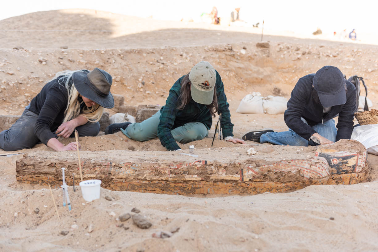 Fig. 2. Archaeological conservators (L-R) Heather White, Chantal Stein, and Hiroko Kariya in the early stages of on-site conservation at the Shunet el-Zebib. Photo: Ayman Damarany / North Abydos Expedition © 2019