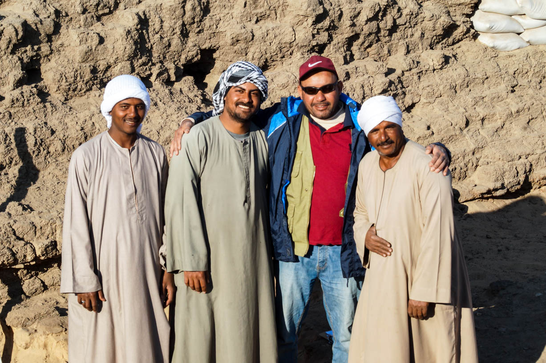 Fig. 20. Archaeologist Mohamed Abul-Yazid (second from right) with archaeological technicians (L-R) 'Abd al-Rahman al-Daba, Mohamed Kamal 'Abd al-Hamid, and Waji Hamed 'Ali of Quft, at the Shunet el-Zebib. Photo: Ayman Damarany / North Abydos Expedition © 2019