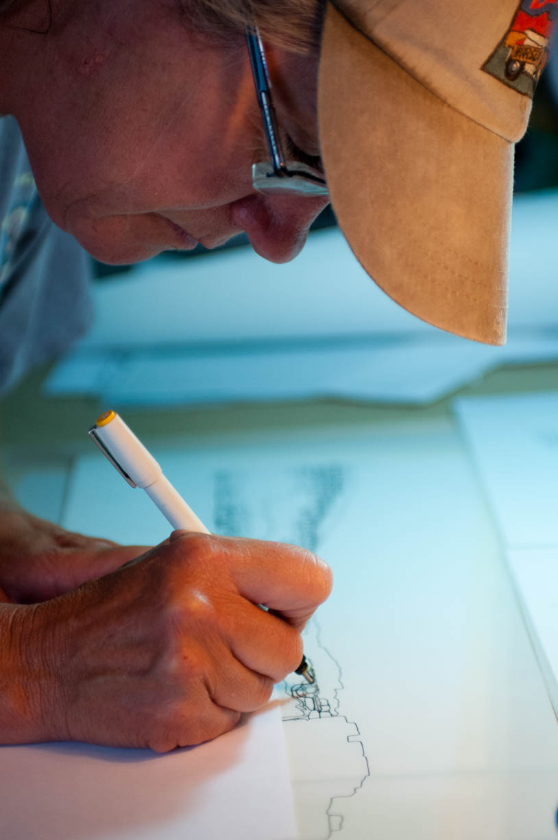 Fig. 19. Archaeologist Kay Barnett inking a detailed scaled drawing of the Shunet el-Zebib. Photo: Gus Gusciora / North Abydos Expedition © 2012