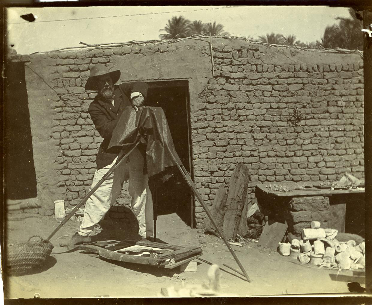 "Fig. 10. Often called the ""father of archaeology"" for his pioneering field methods and attention to small and fragmentary artifacts, Flinders Petrie — seen here at Abydos in 1899 — was never far from a  maqtaf  like the one pictured here at his feet (lower left). Photo courtesy of the Petrie Museum of Egyptian Archaeology © UCL"