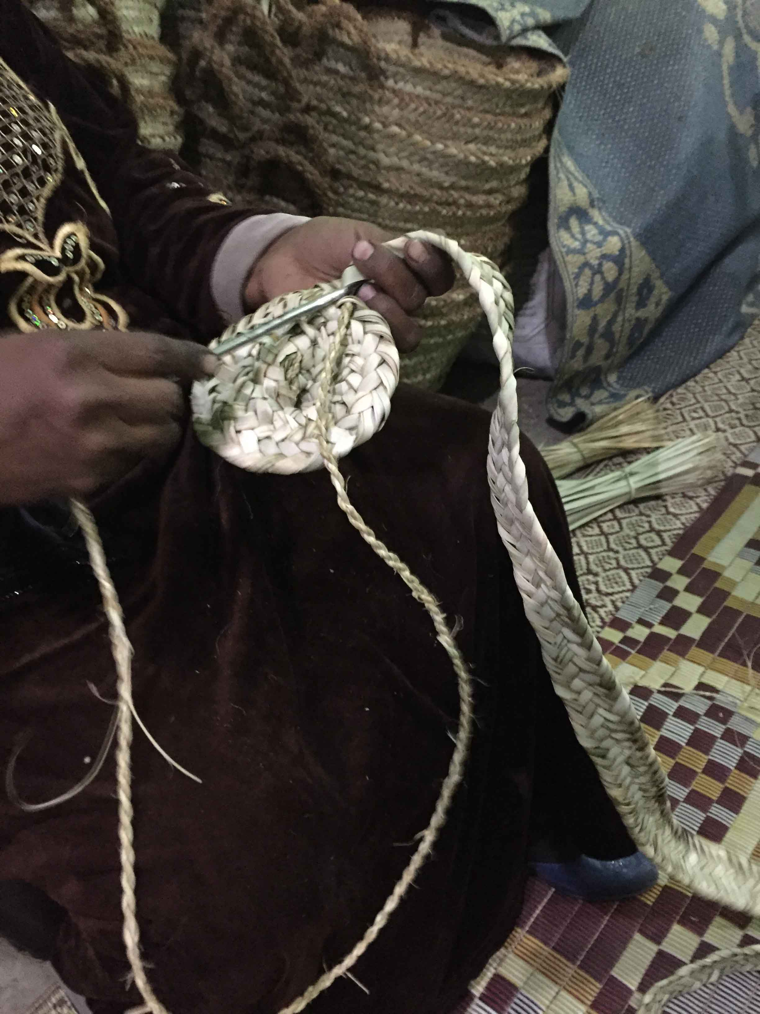 Fig. 16. Beginning the process of sewing around the inner edge of the woven band with a large metal needle threaded with twine (see photo at left & video below). Photo: Wendy Doyon / North Abydos Expedition © 2019