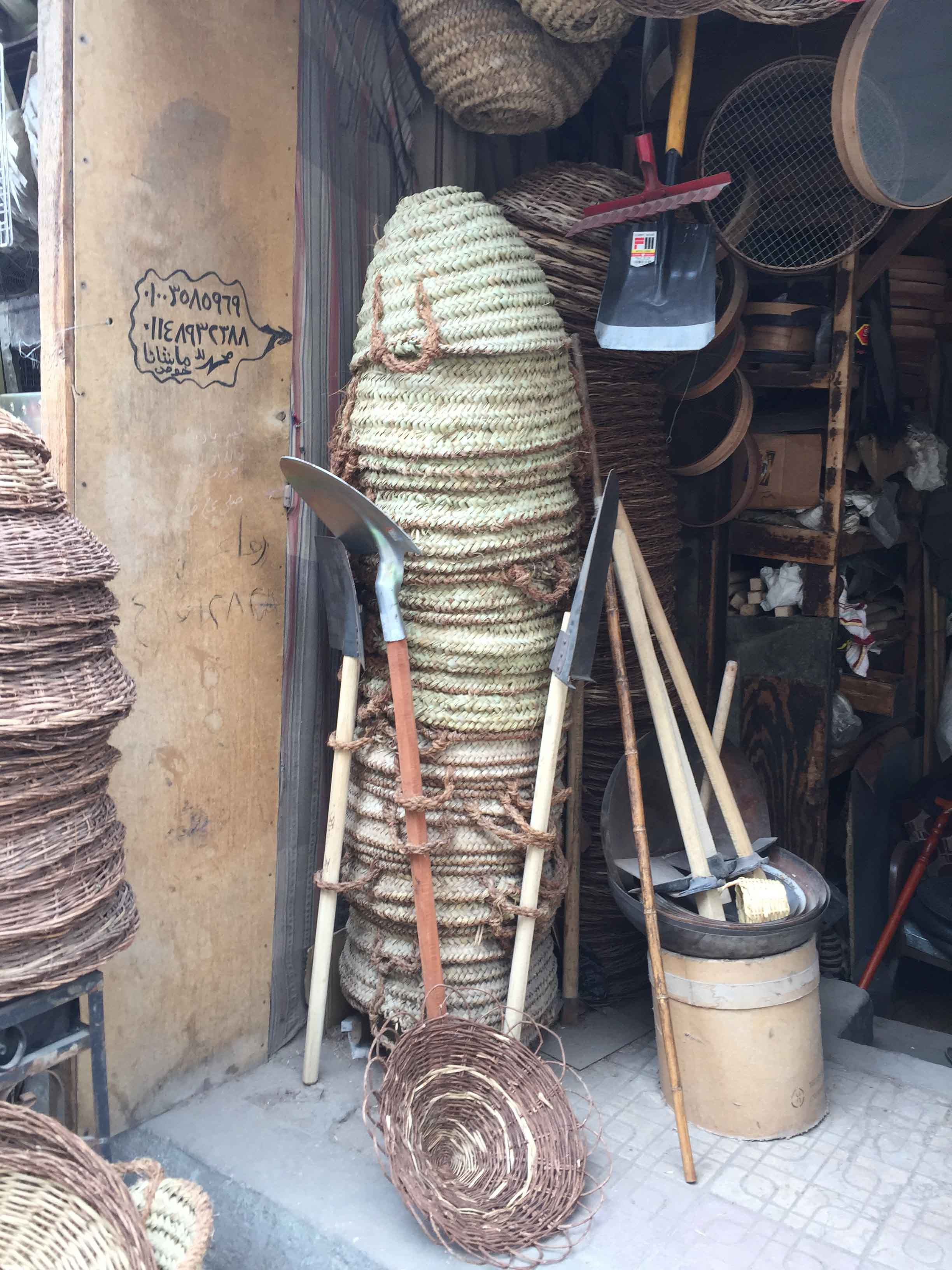 Fig. 18. Outside a basket & hardware shop on Shari'a al-Muizz in Cairo, where although it is difficult to tell from a distance, the palm-leaf baskets are of a much cheaper, mass-market quality than their Upper Egyptian counterparts. Photo: Wendy Doyon / North Abydos Expedition © 2019