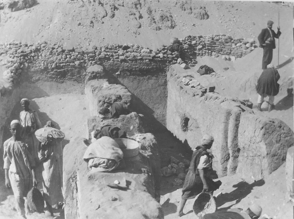Fig. 11. This image, taken during Petrie's excavations at Umm al-Qa'ab in the tomb of King Khasekhemwy — Second Dynasty builder of the Shunet el-Zebib — illustrates two different kinds of palm-leaf basket in use at the time, a shallow type used for moving dirt and sand (at left) and the larger type still in use today (at right). Note the  kirbal  placed on the wall top at center. Photo courtesy of the  Egypt Exploration Society