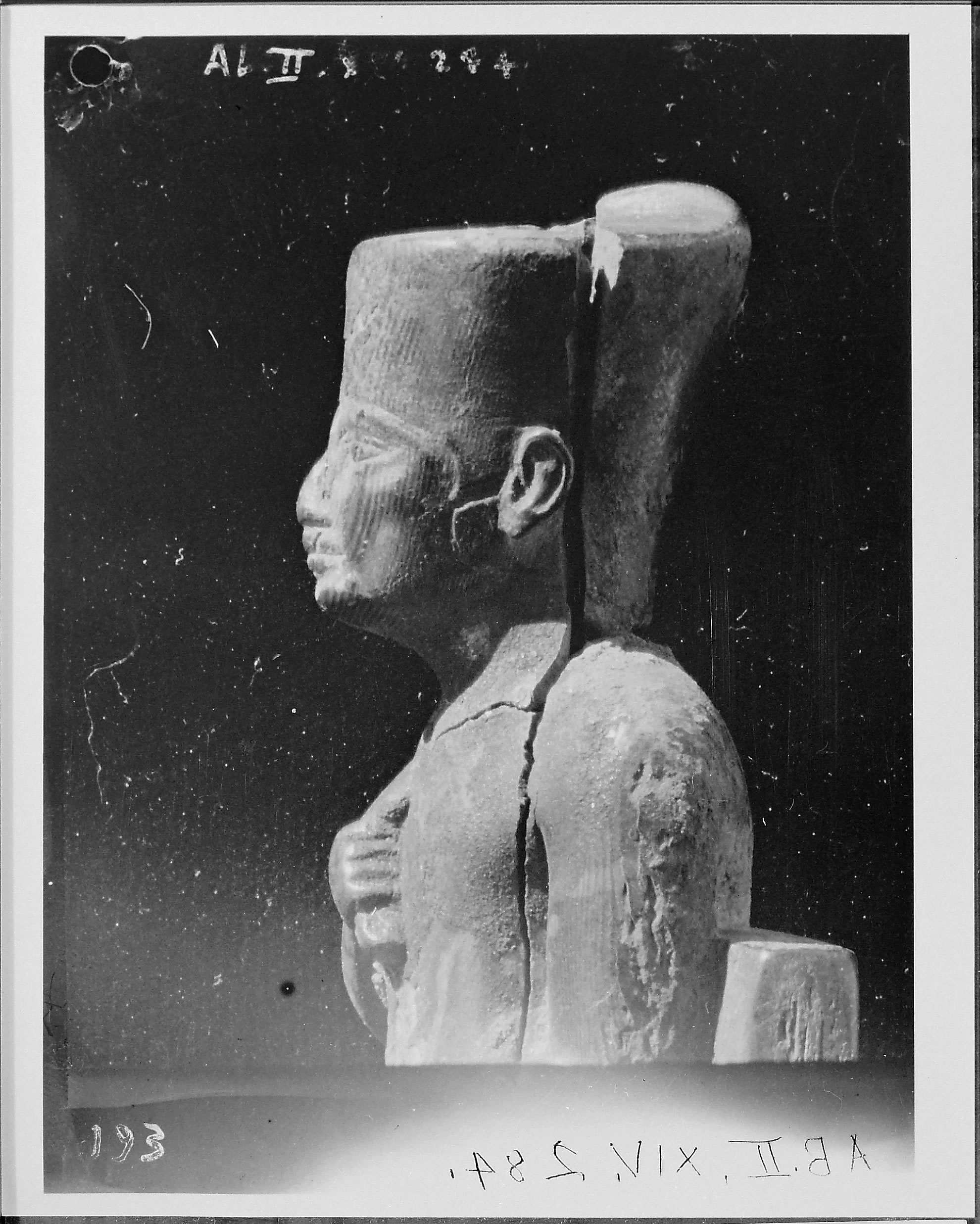 Fig. 3. Side view showing Petrie's reattachment of the head to the body of the statuette in 1903. Photo courtesy of the  Egypt Exploration Society